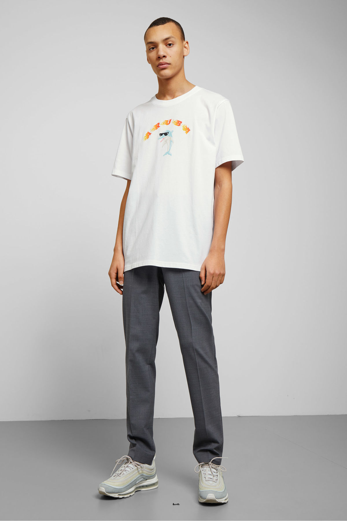 Model side image of Weekday frank aruba t-shirt in white