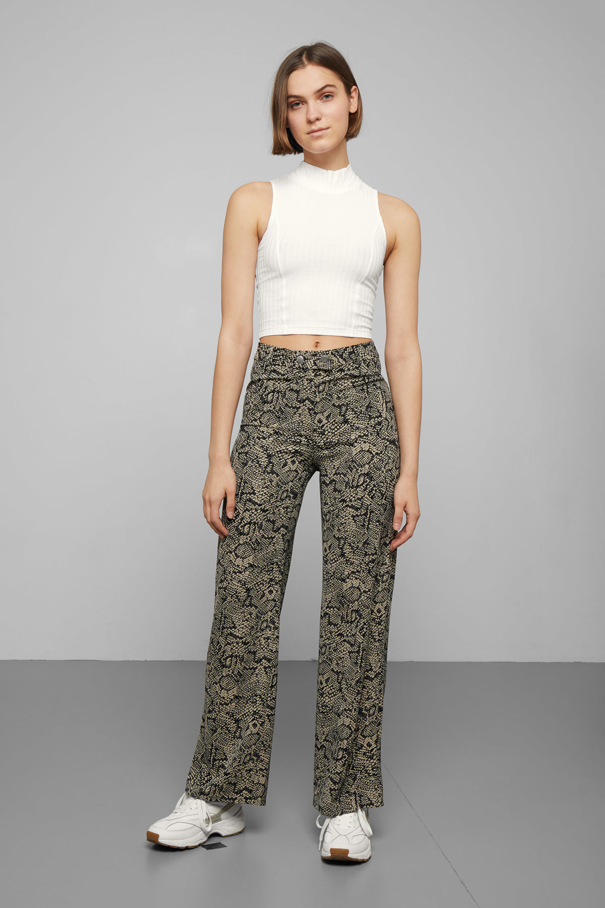 Model front image of Weekday magma printed trousers in beige