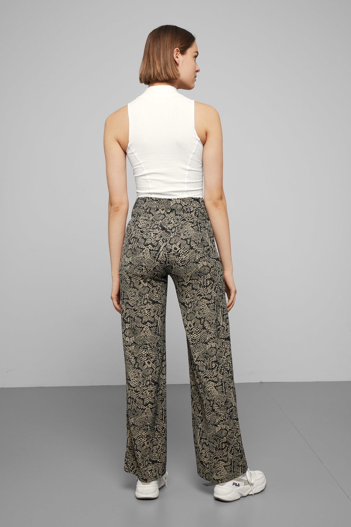 Model back image of Weekday magma printed trousers in beige