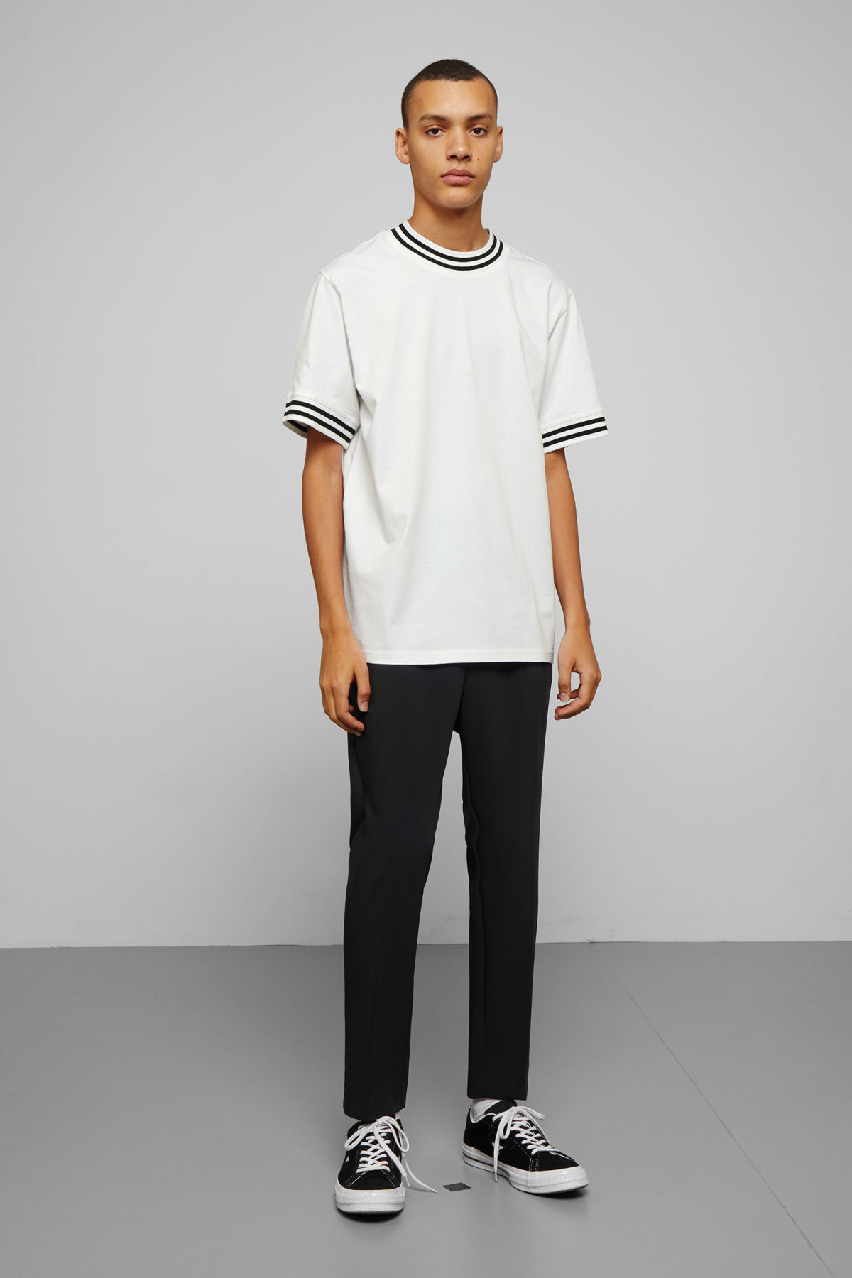 Model side image of Weekday mark t-shirt in white