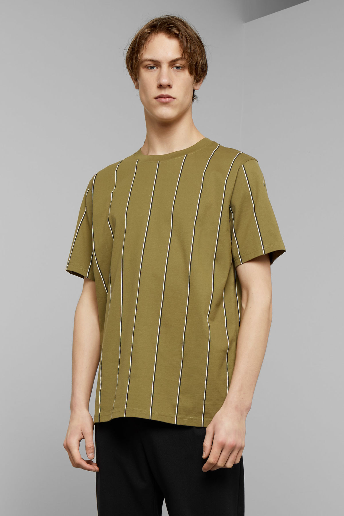 Model front image of Weekday frank vertical t-shirt in green