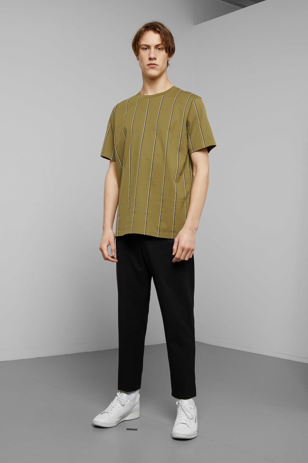 Model side image of Weekday frank vertical t-shirt in green