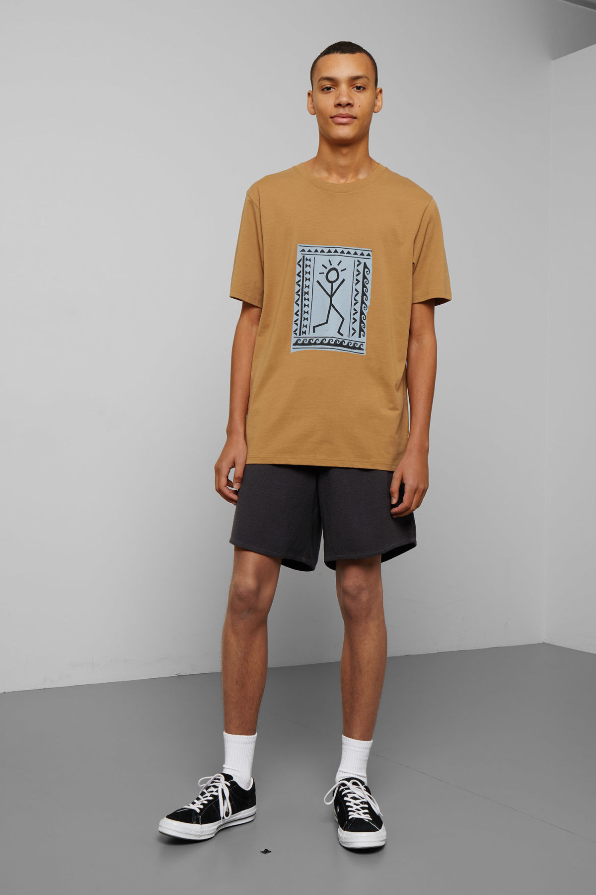 Model side image of Weekday frank human t-shirt in yellow