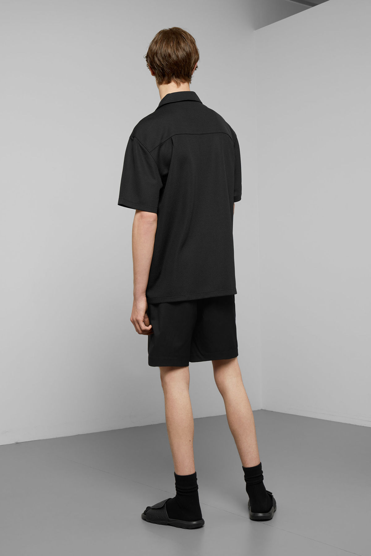 Model back image of Weekday skyway shirt  in black