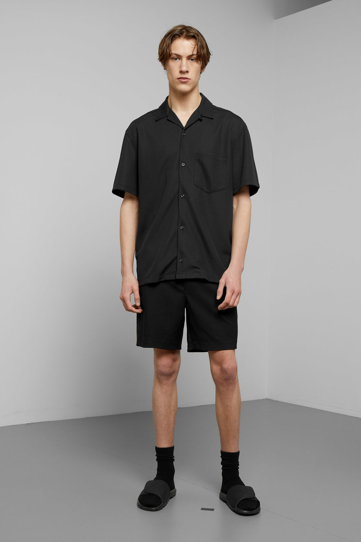 Model side image of Weekday skyway shirt  in black