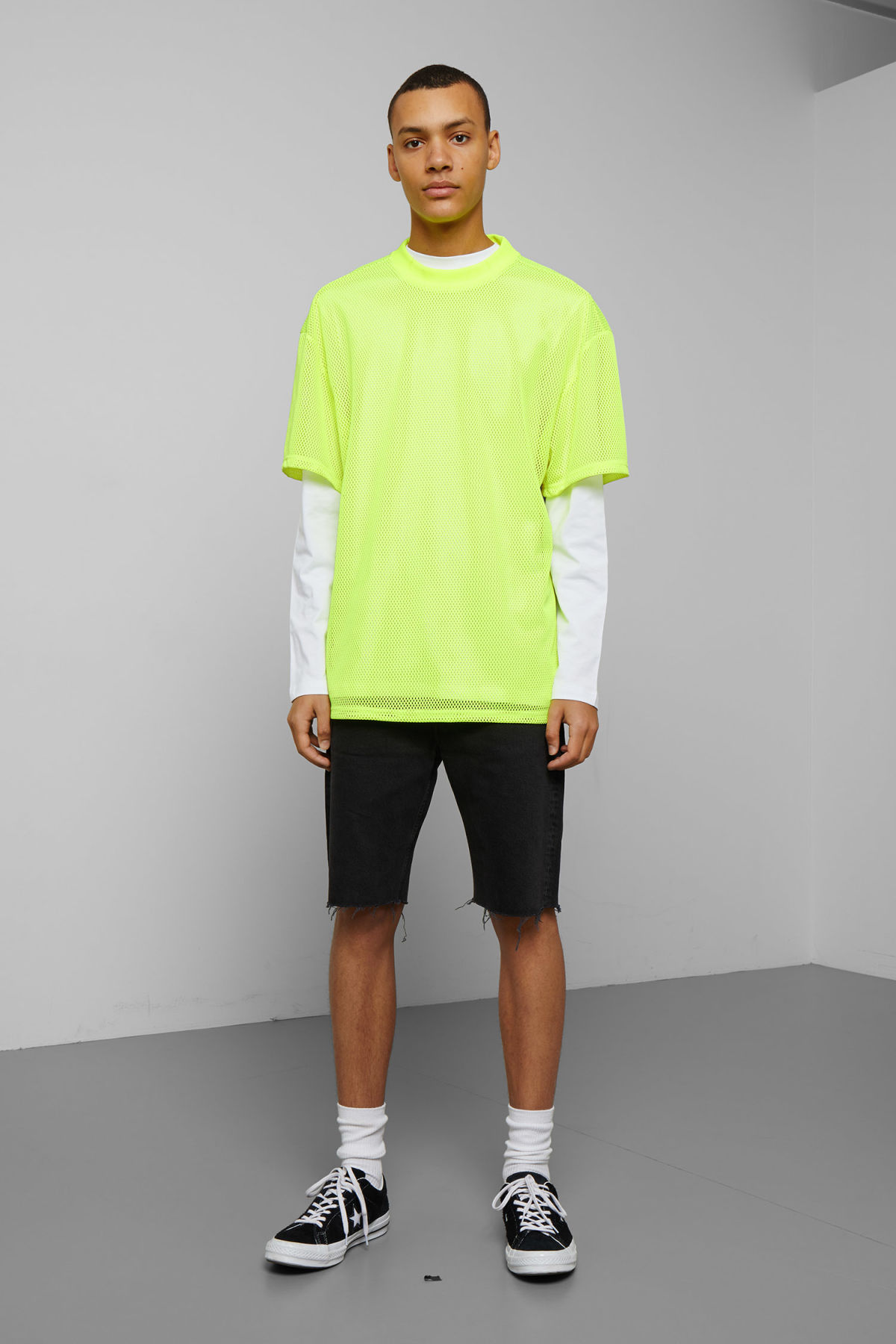 Model side image of Weekday great mesh t-shirt in yellow
