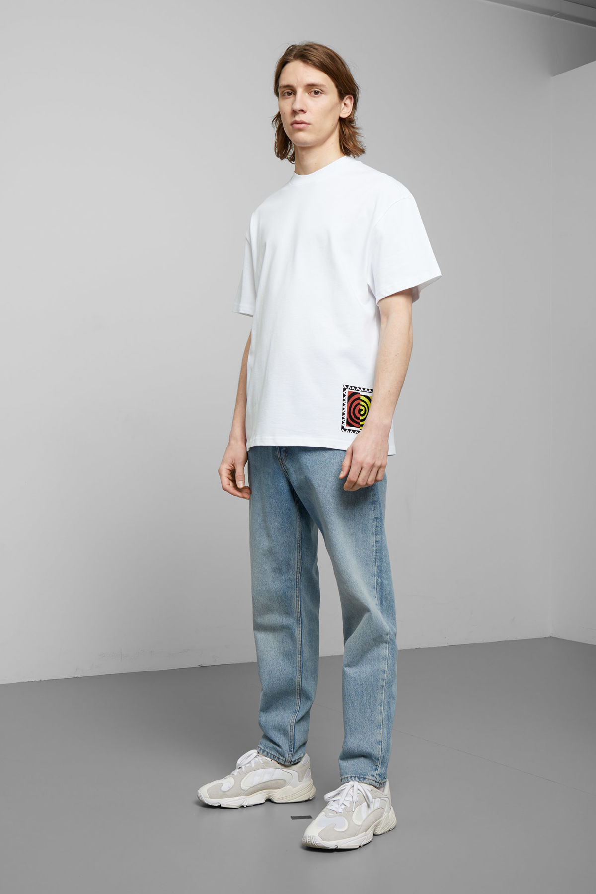 Model side image of Weekday great swirl t-shirt in white