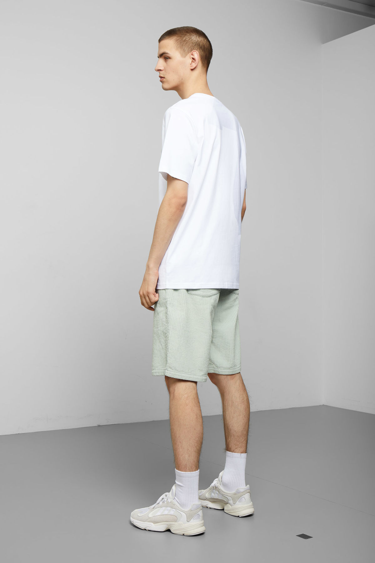 Model back image of Weekday frank fish & chips t-shirt in white