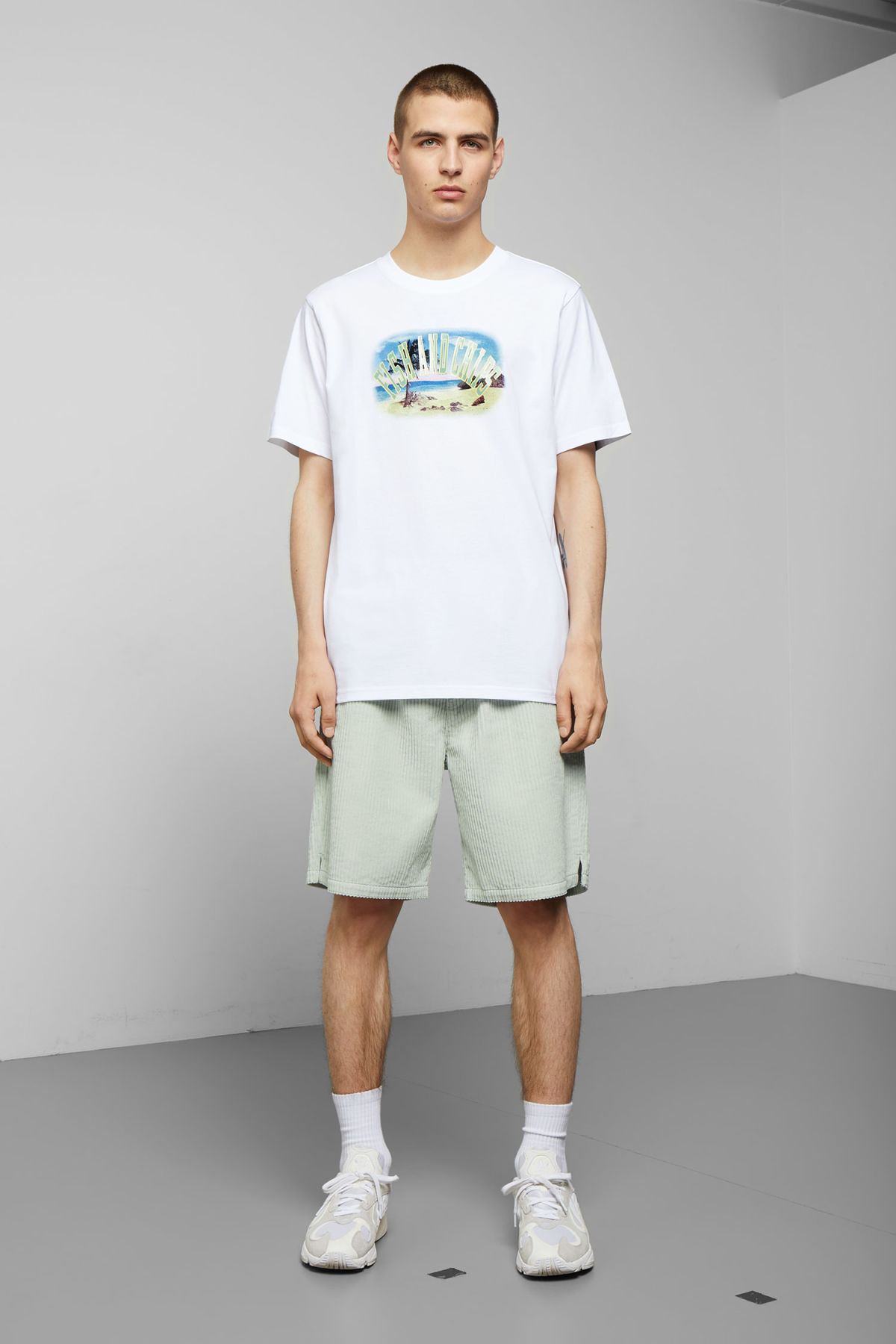 Model side image of Weekday frank fish & chips t-shirt in white
