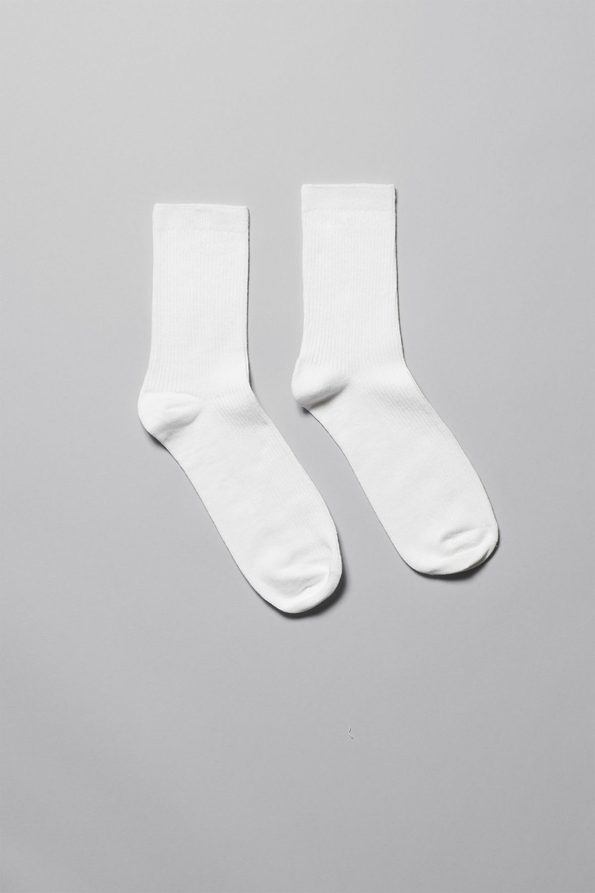 Front image of Weekday foot rib socks in white
