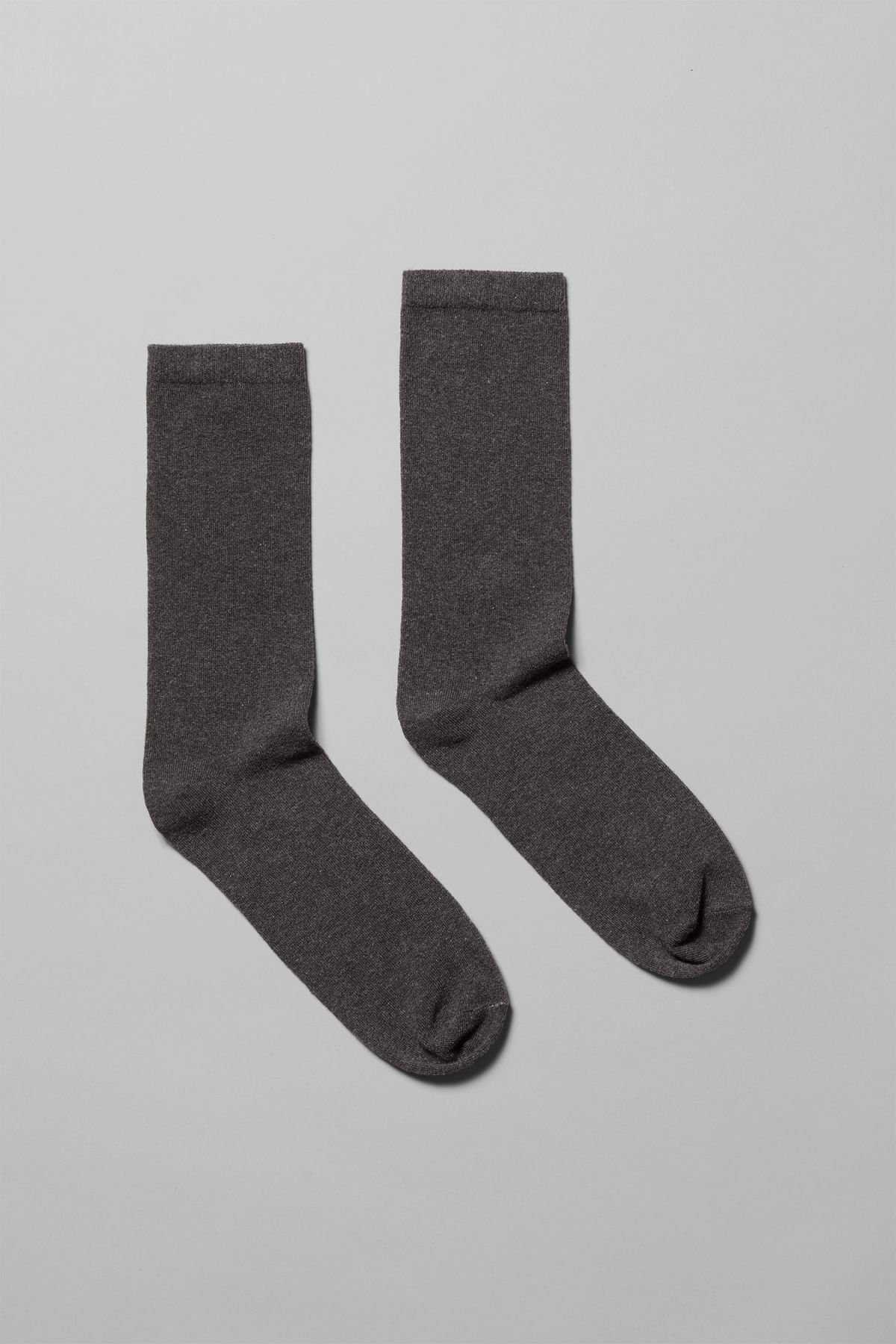 Front image of Weekday feet sock in black