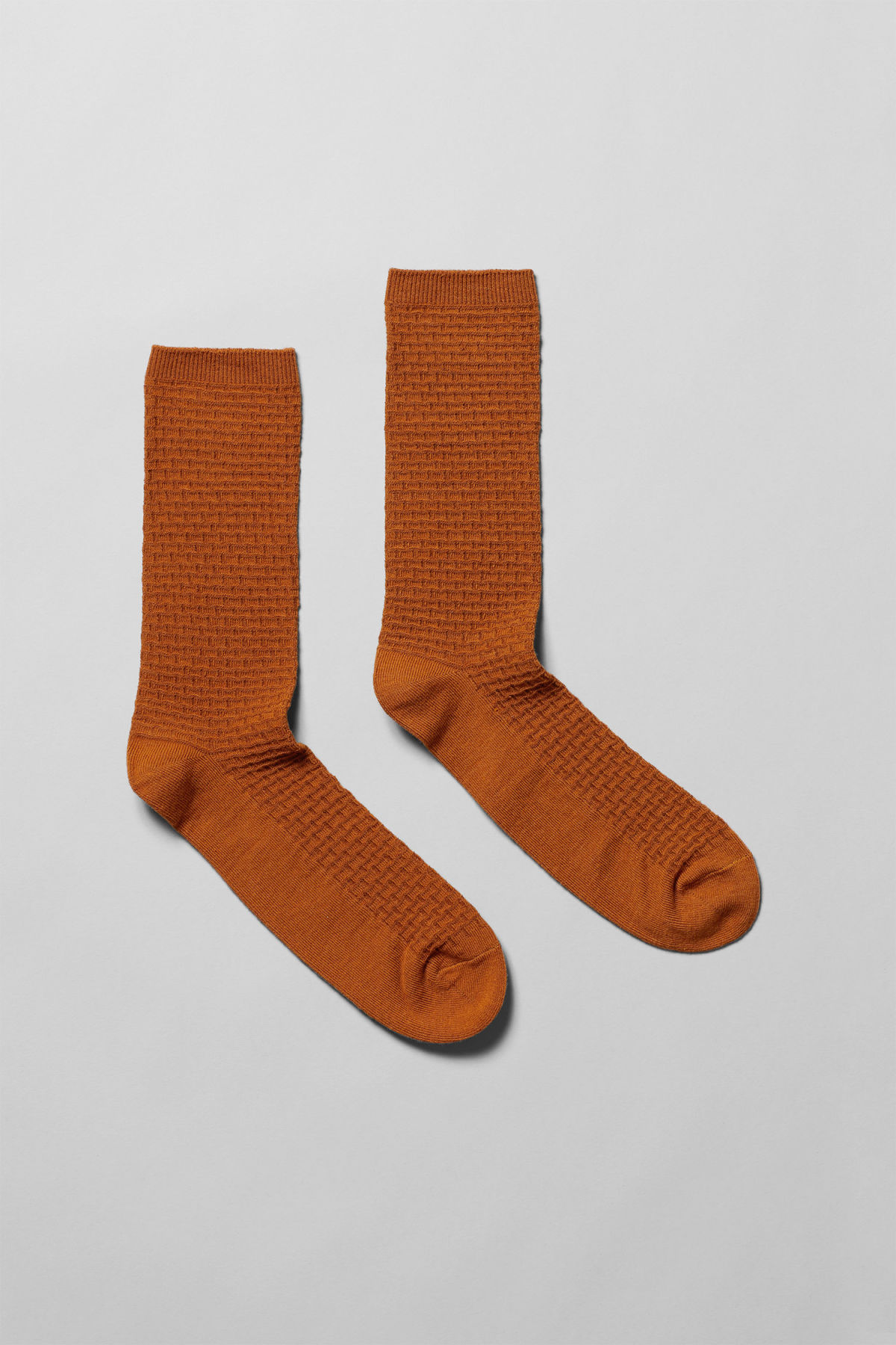 Front image of Weekday fond socks in orange