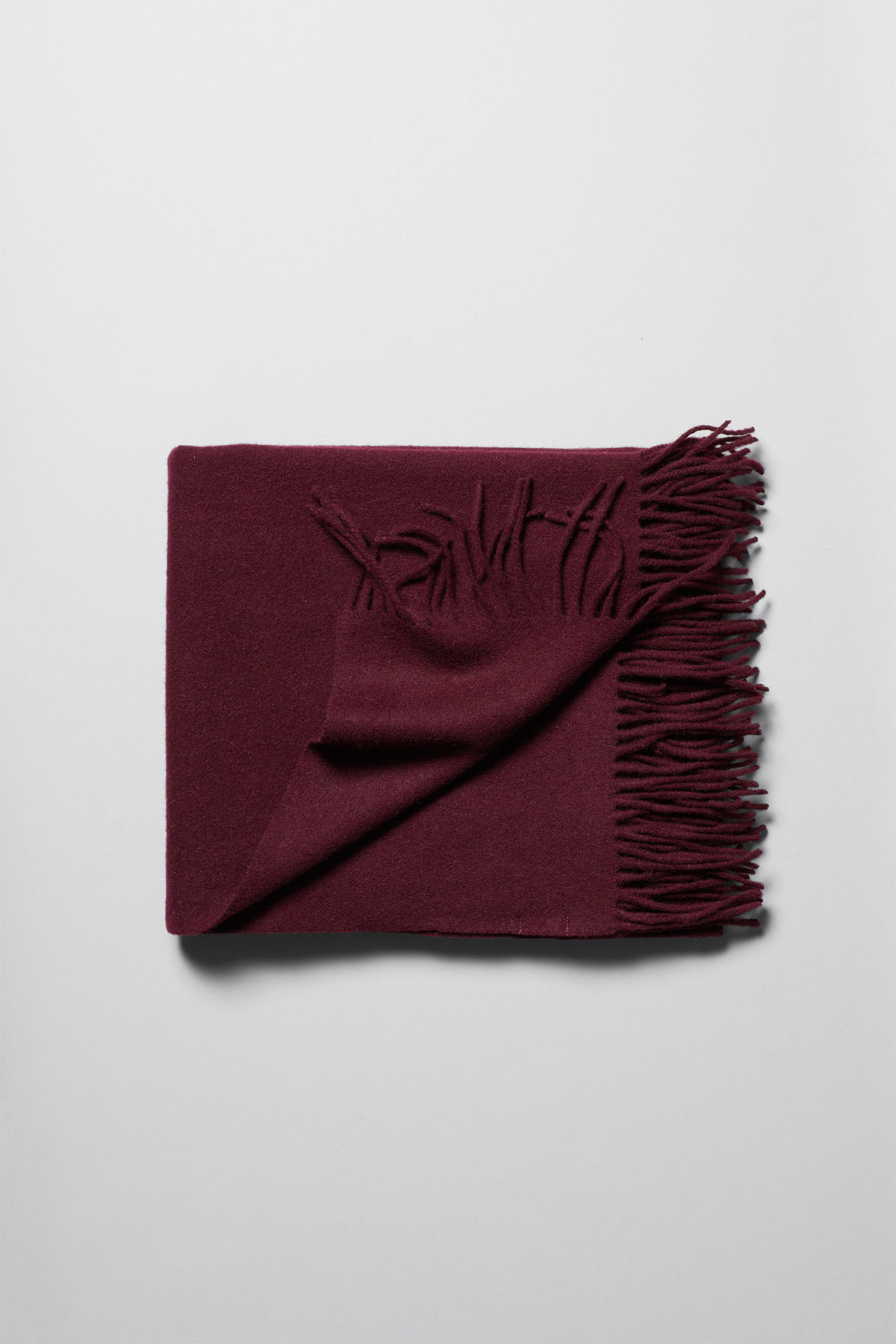 Front image of Weekday tuva shawl in red