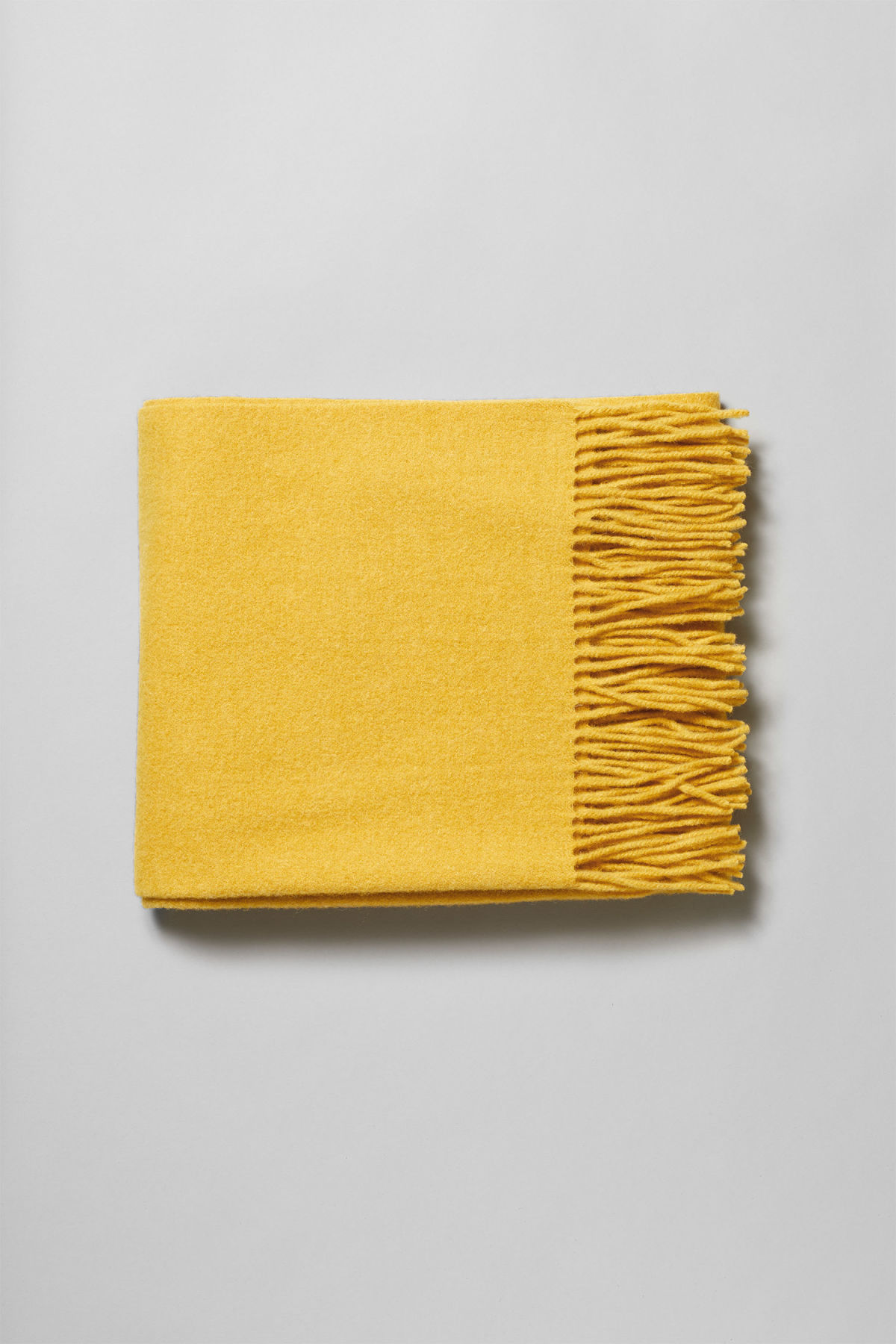 Front image of Weekday tuva shawl in yellow