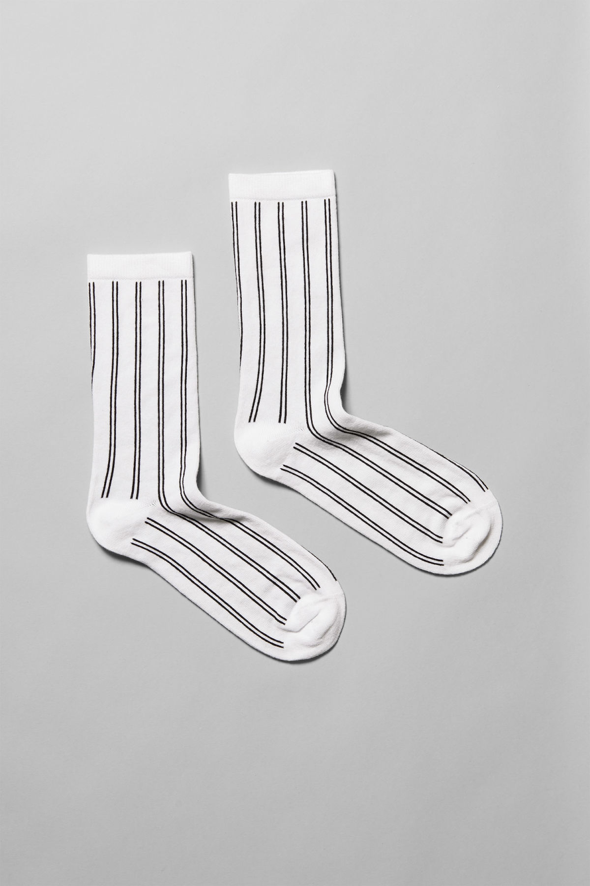 Front image of Weekday feet jacquard socks in white