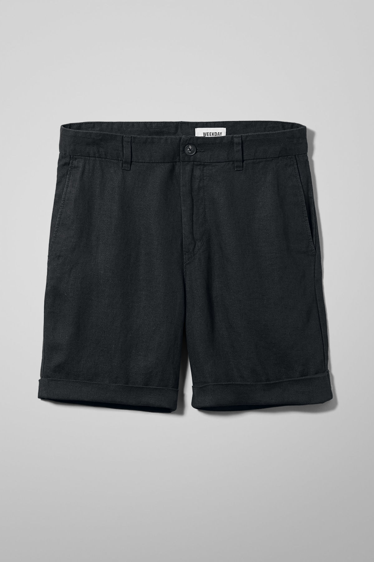 Front image of Weekday mash shorts in black
