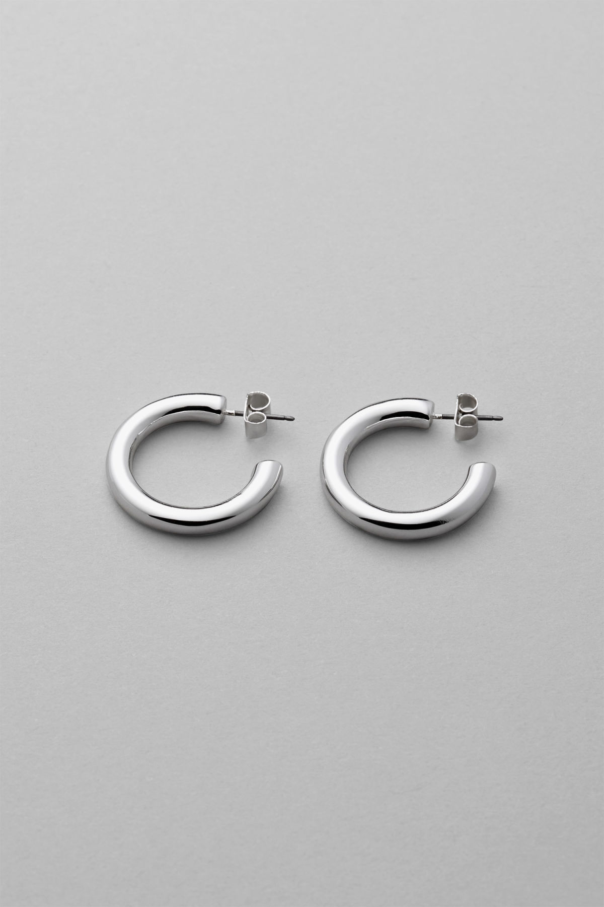 Front image of Weekday thick hoop earrings in silver