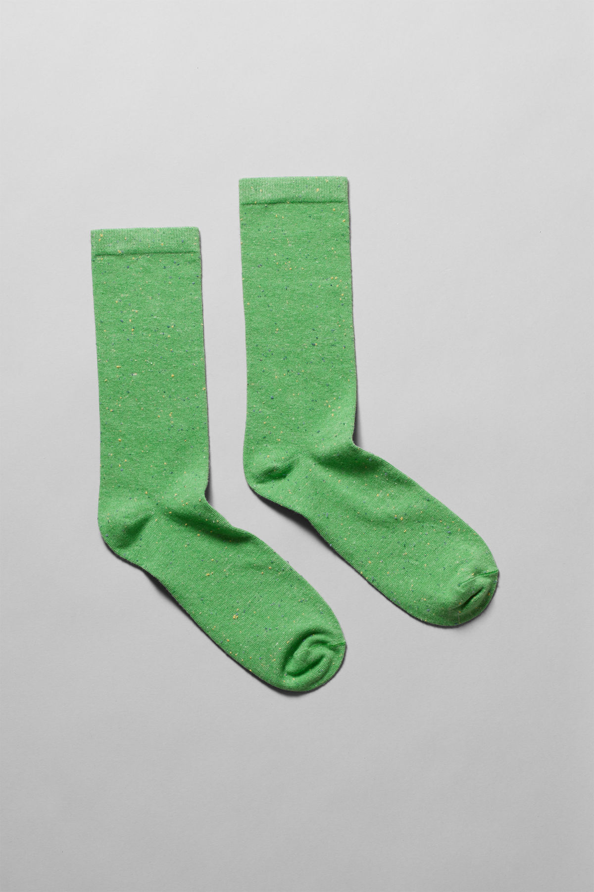 Front image of Weekday feet neps socks in green