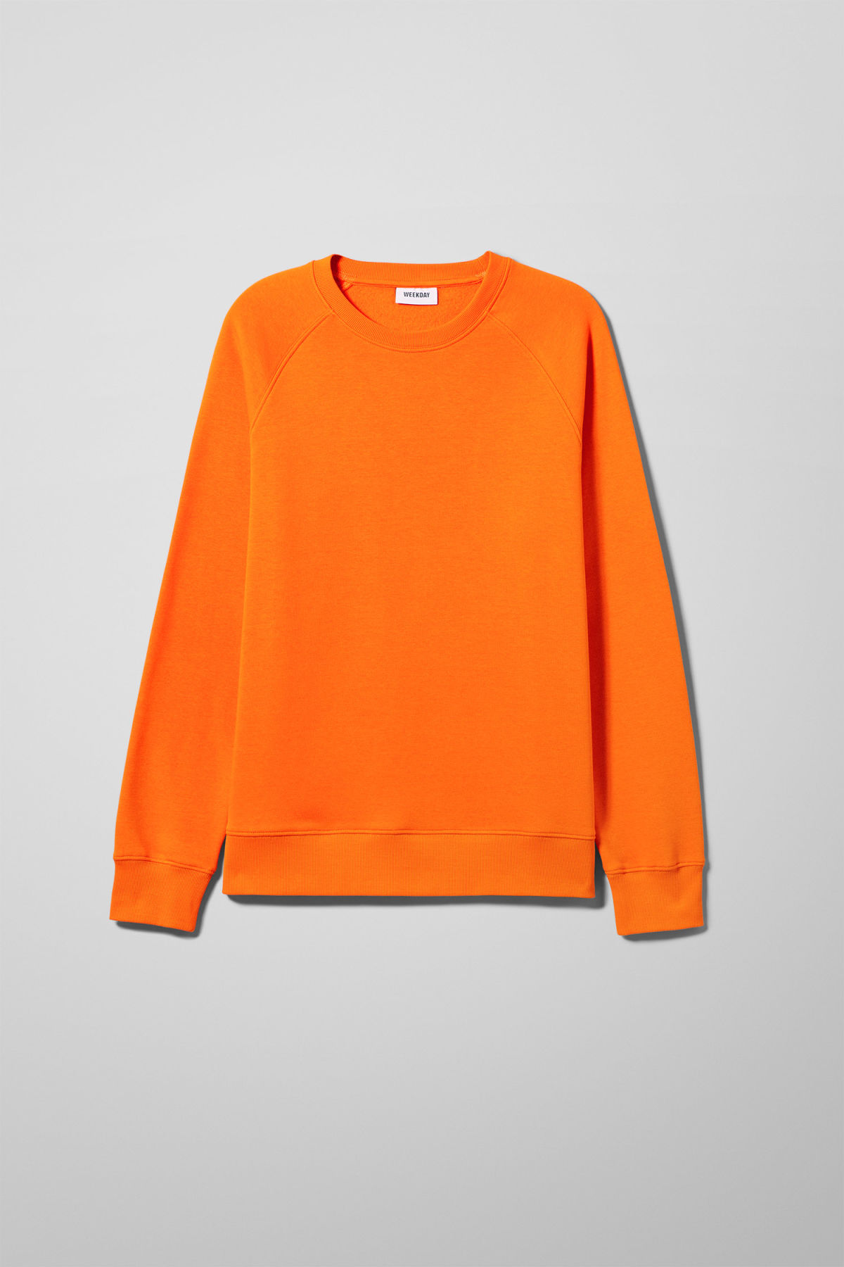 Front image of Weekday paris sweatshirt in orange
