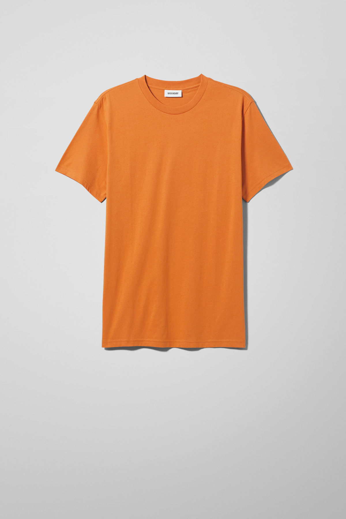 Front image of Weekday alan t-shirt in orange