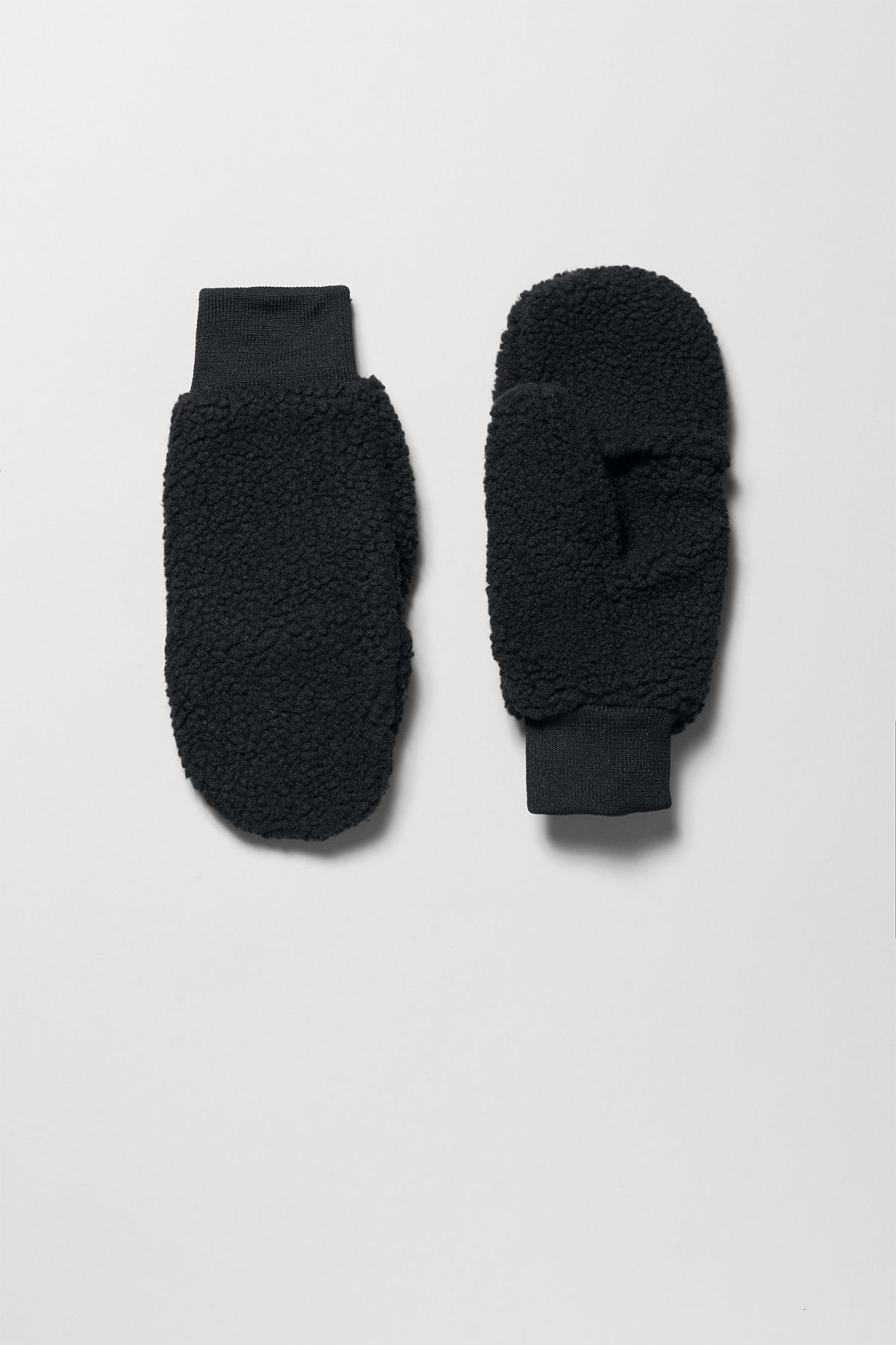 Front image of Weekday sign mittens in black