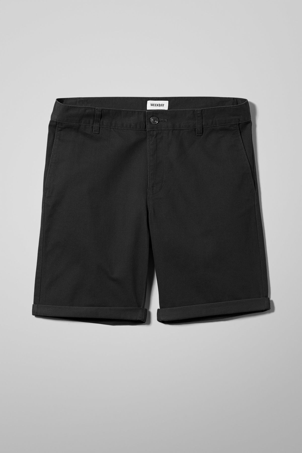 Front image of Weekday acid shorts in black