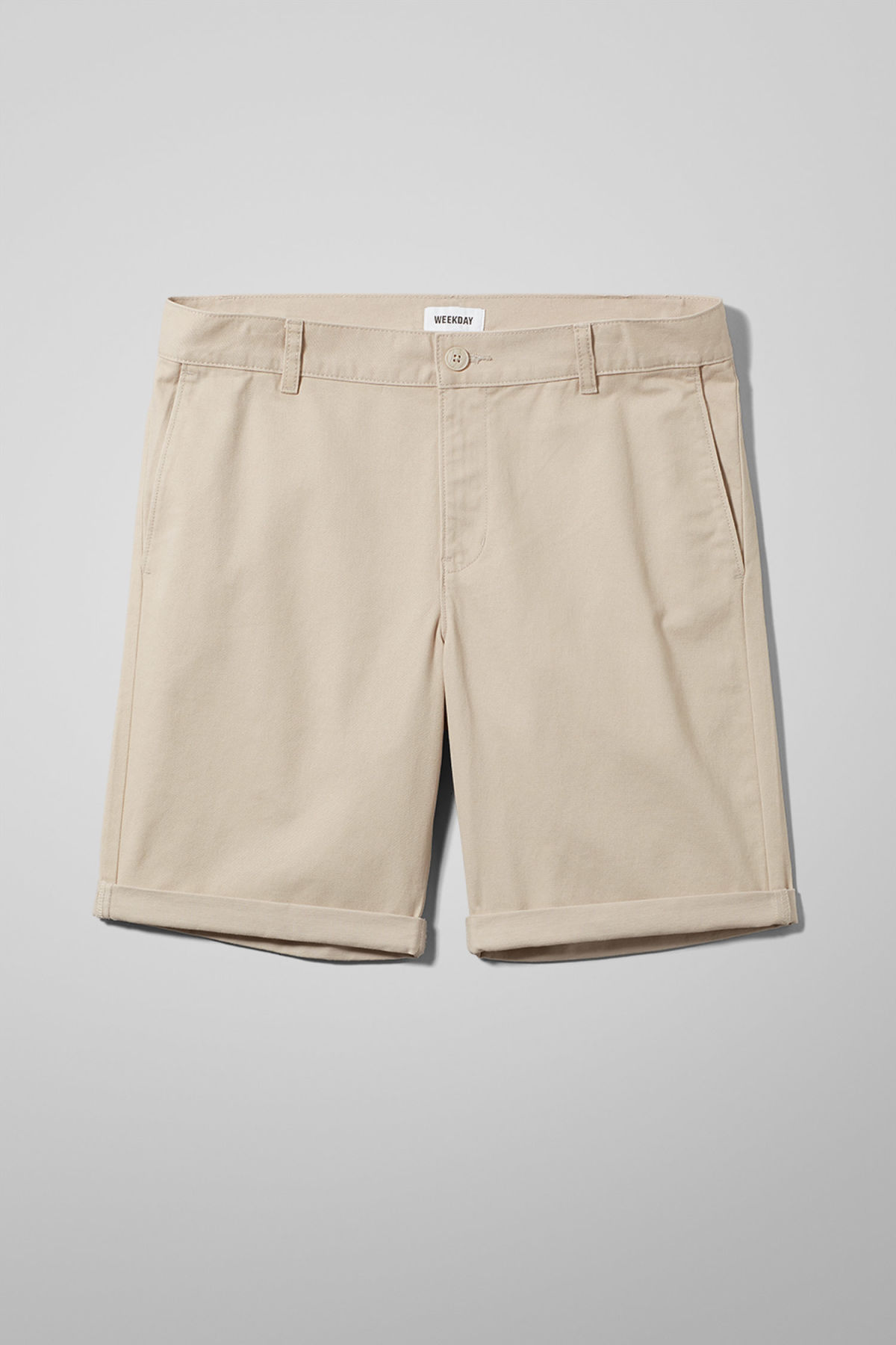 Front image of Weekday acid shorts in beige