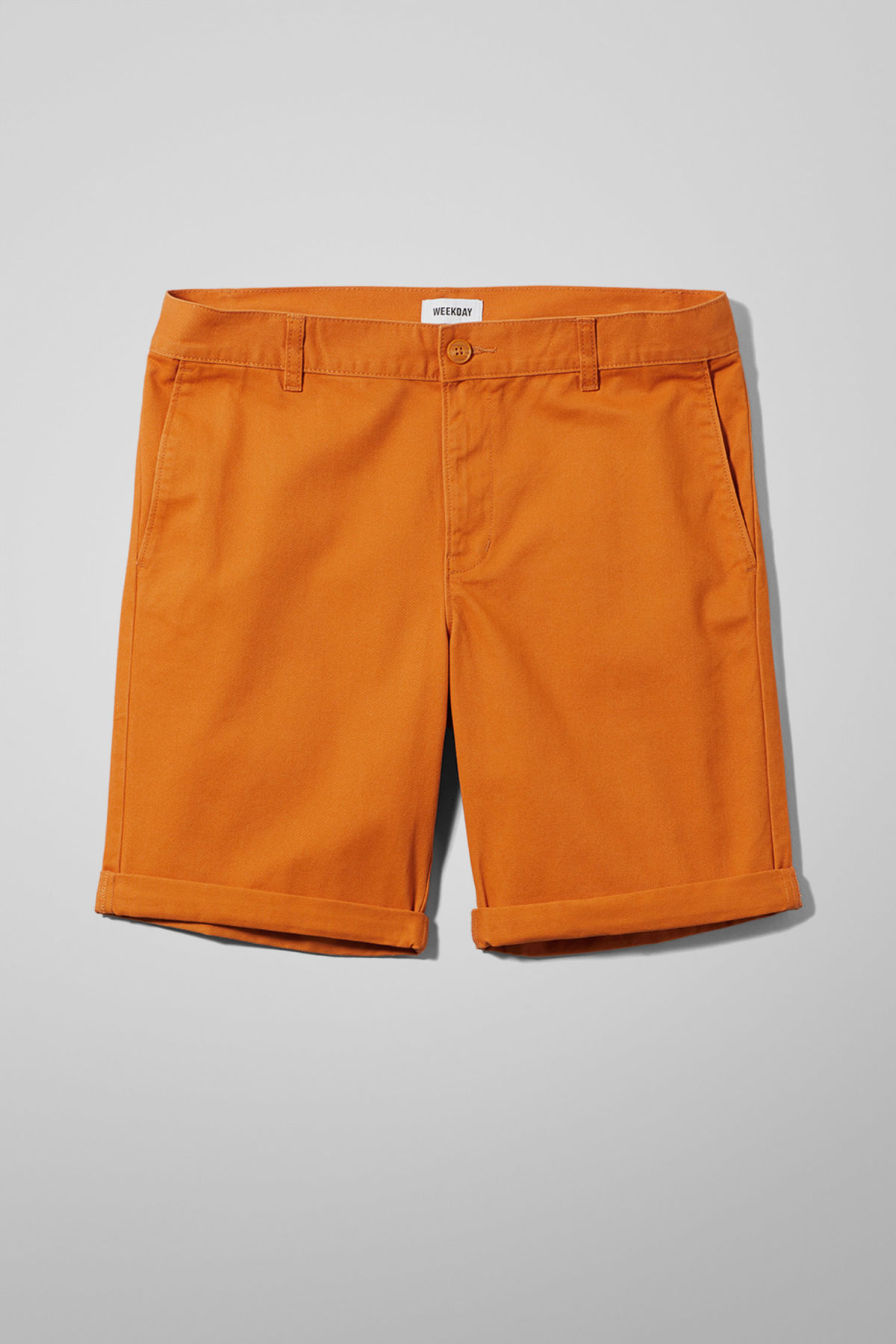 Front image of Weekday acid shorts in orange
