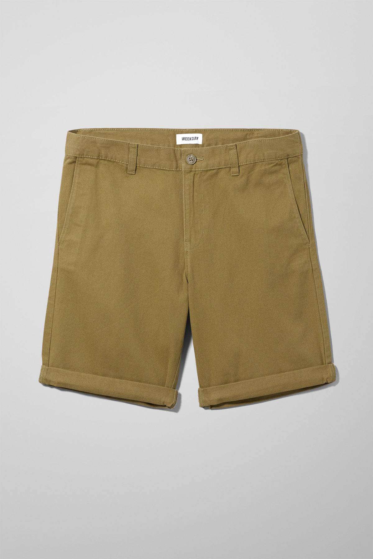 Front image of Weekday acid shorts in green