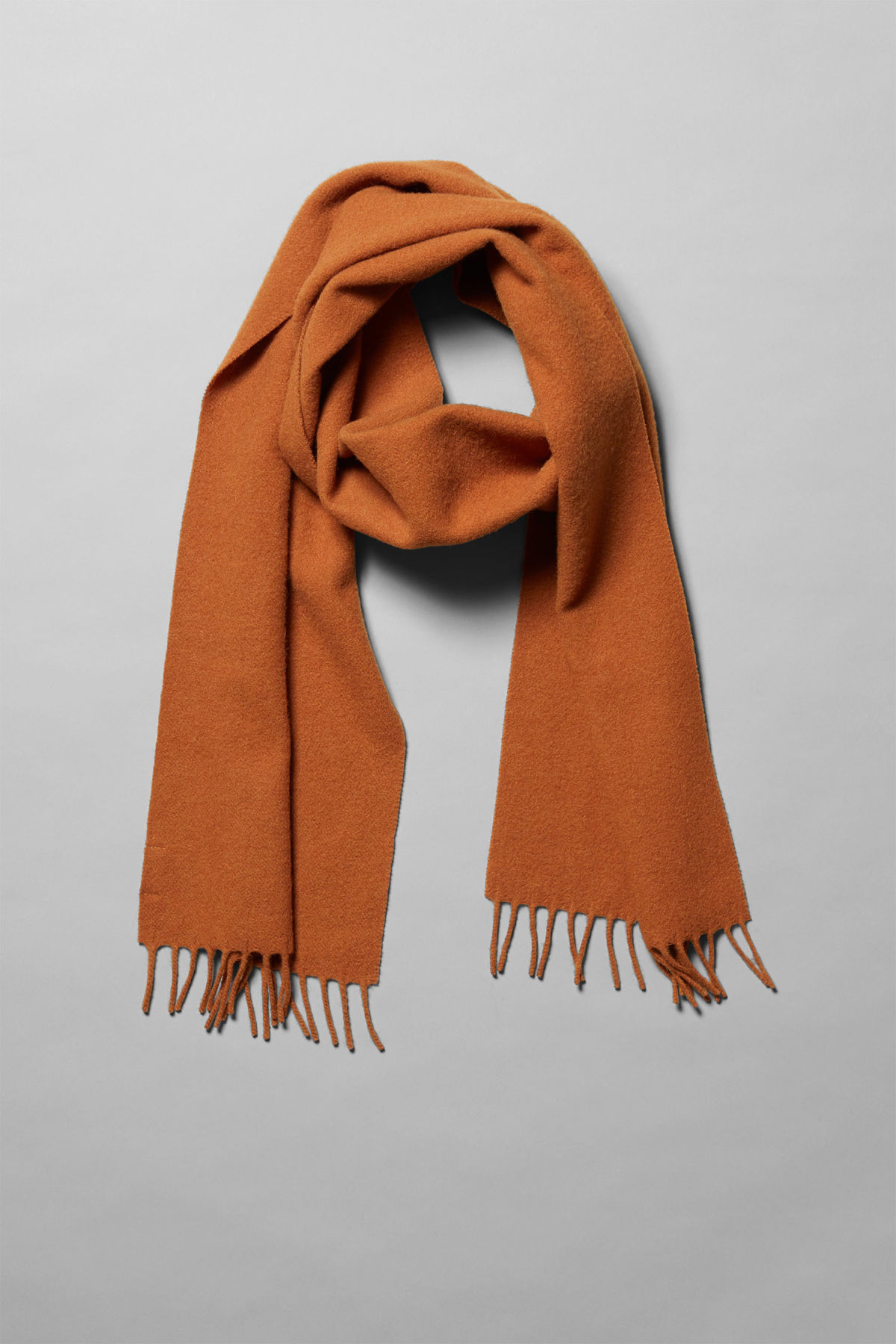 Side image of Weekday orbit scarf in orange