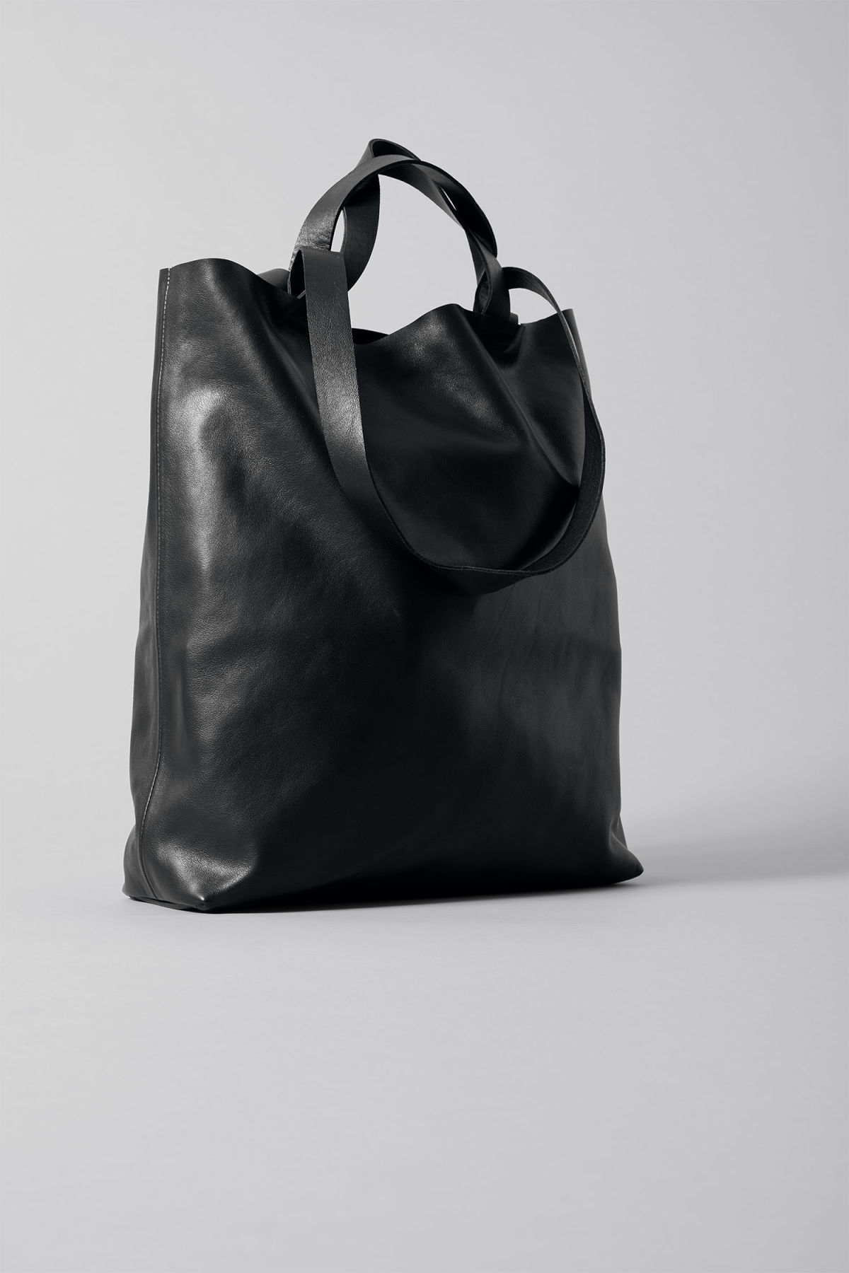 Front image of Weekday sweet leather tote in black