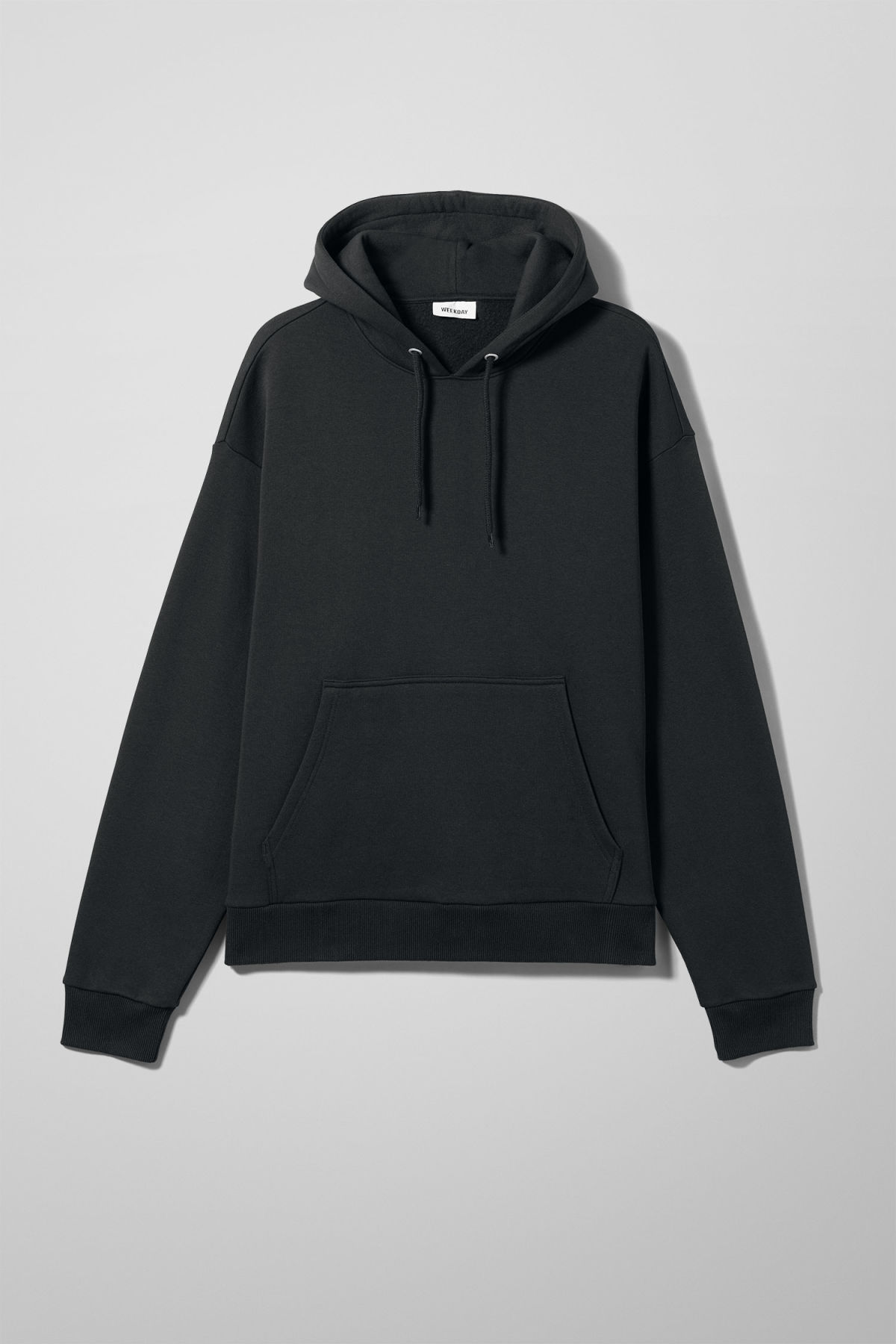 Front image of Weekday big hawk hoodie in black