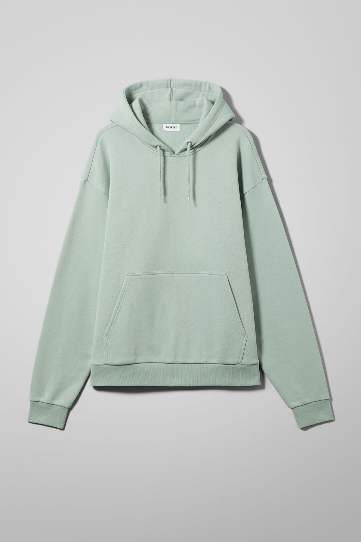 Front image of Weekday big hawk hoodie in turquoise