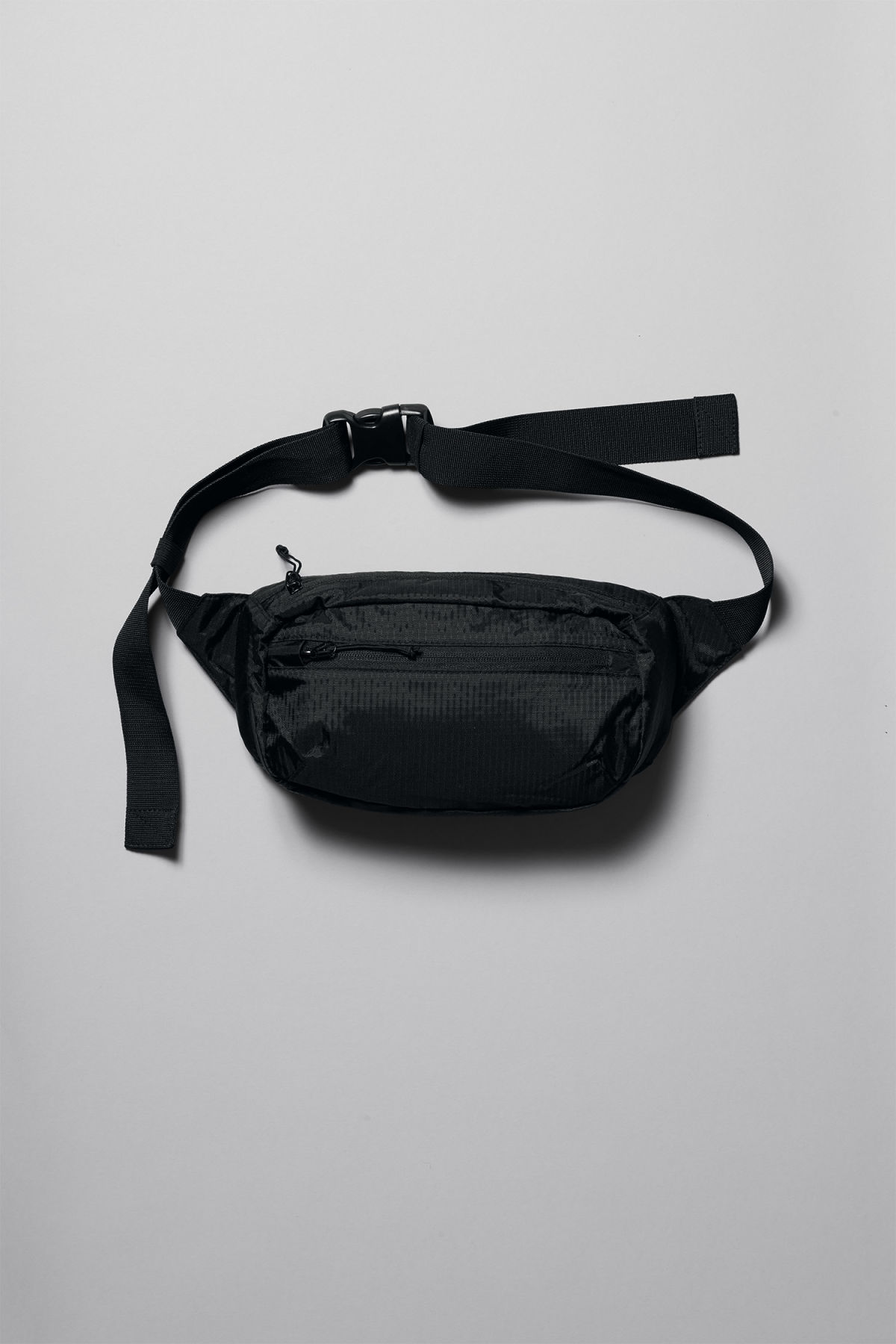Front image of Weekday trip waist bag in black