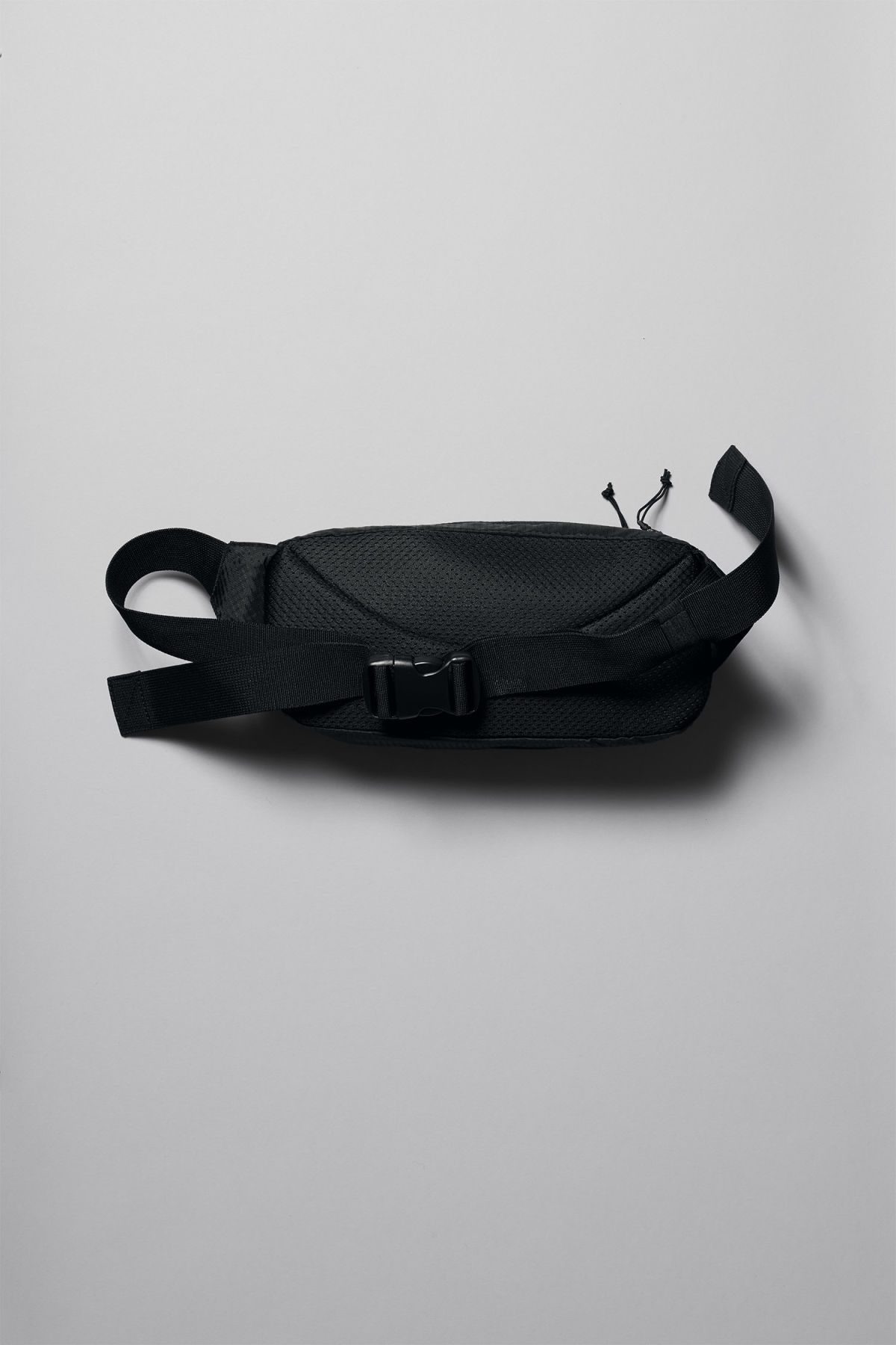 Back image of Weekday trip waist bag in black