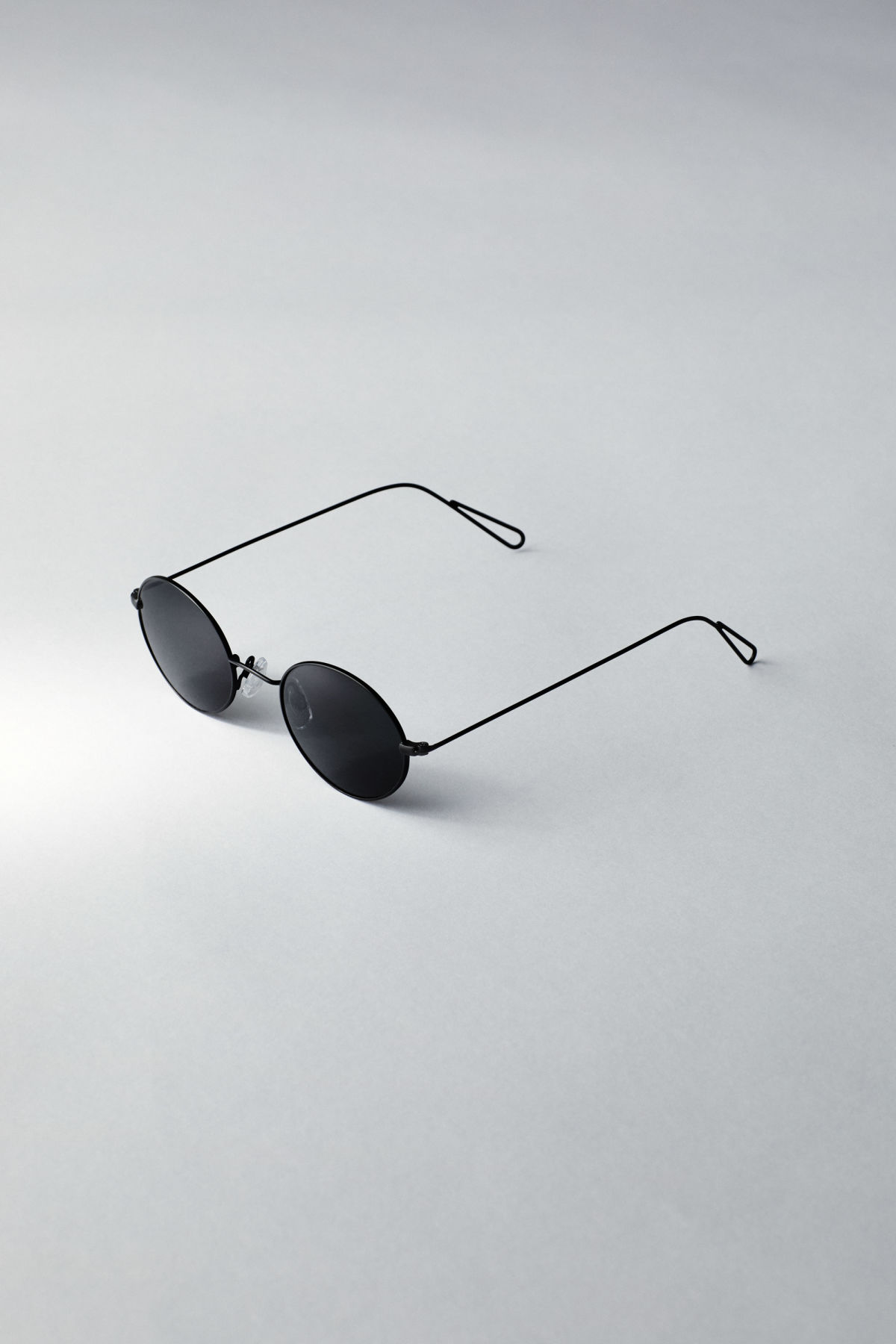 Back image of Weekday trip oval sunglasses in black