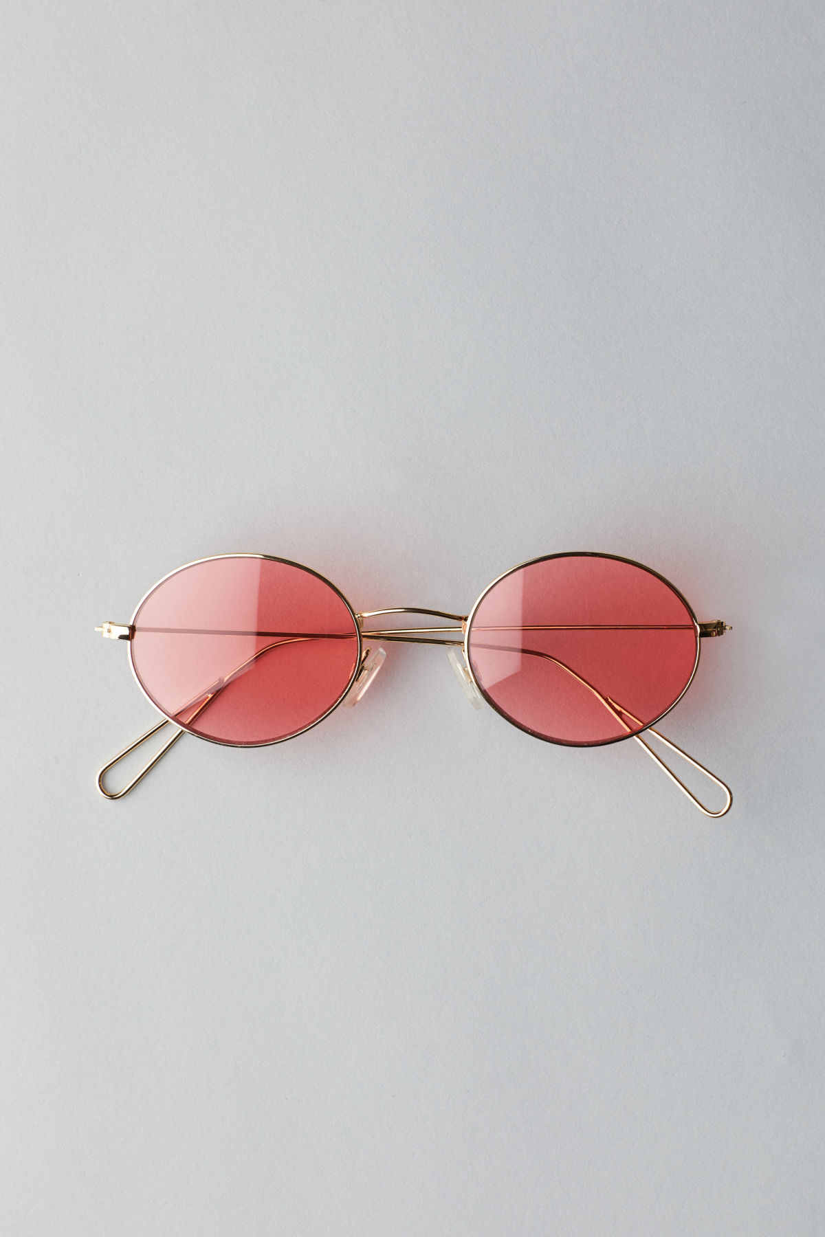 Front image of Weekday trip oval sunglasses in gold