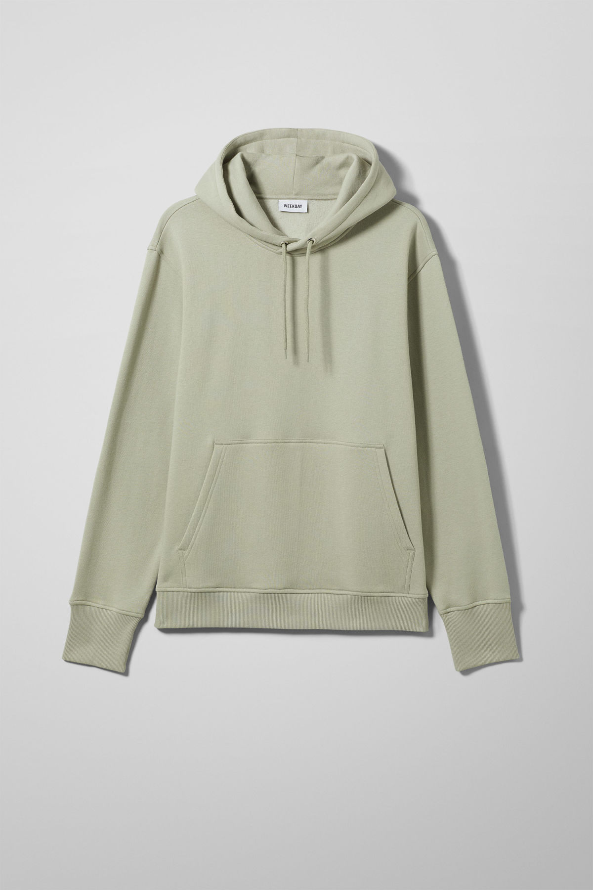 Front image of Weekday hawk hoodie in green