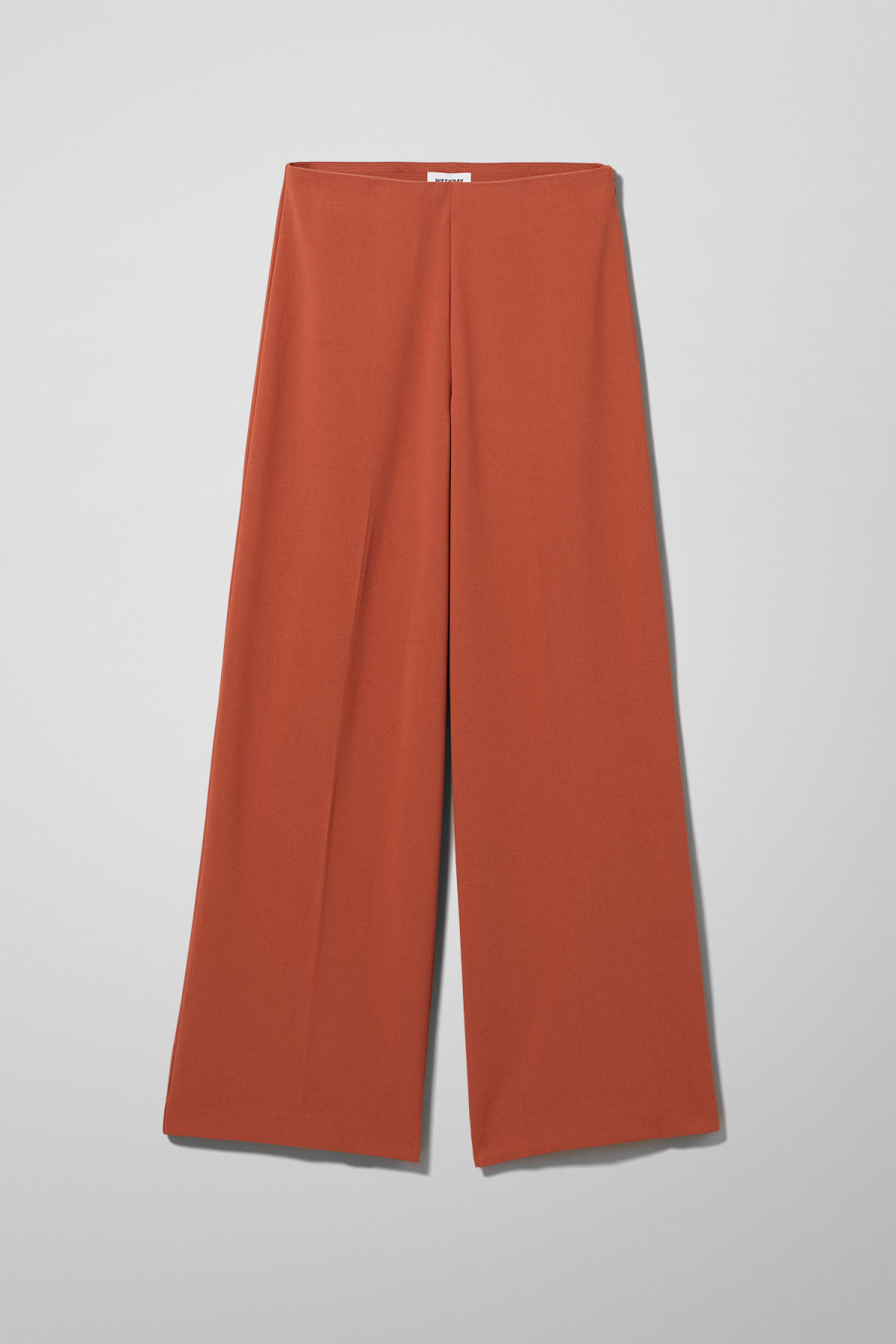 Front image of Weekday julia trousers  in orange