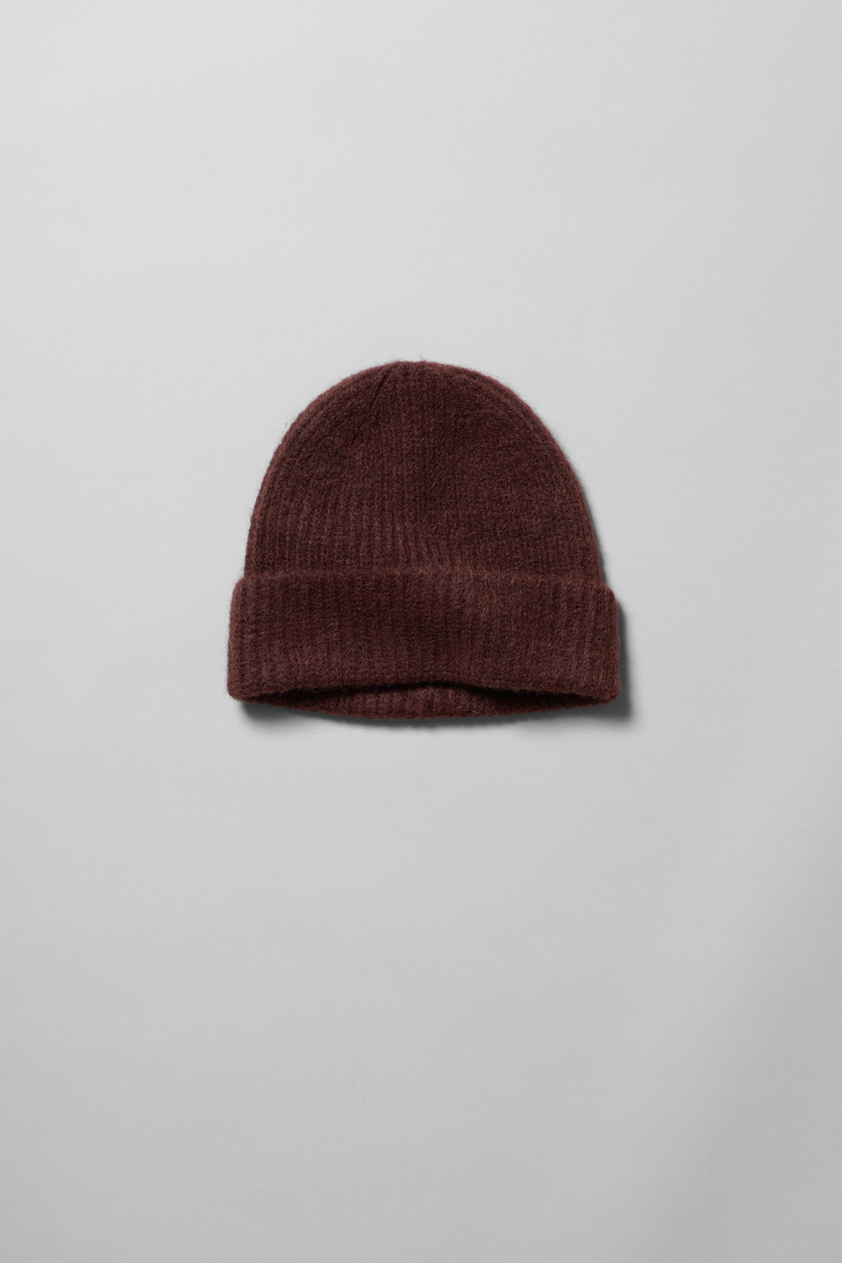 Front image of Weekday snow knit beanie in red