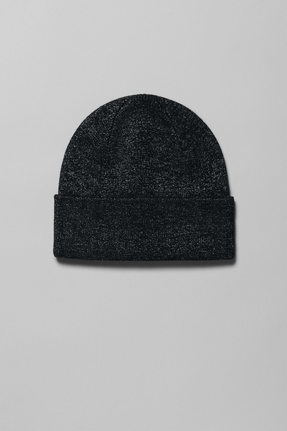 Front image of Weekday star knit beanie in black