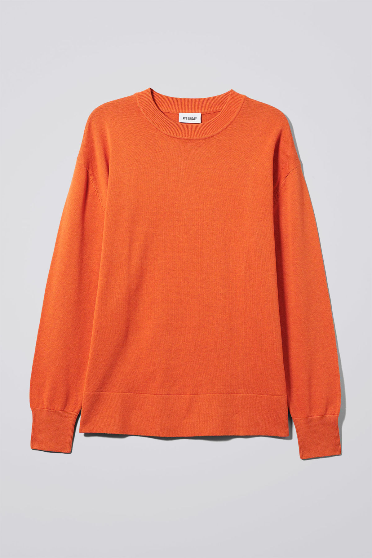 Front image of Weekday earl cotton sweater in orange