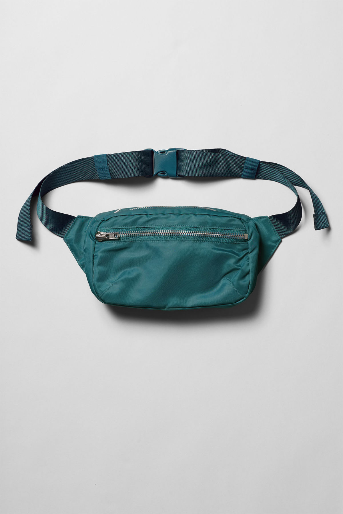 Front image of Weekday wood waist bag in turquoise