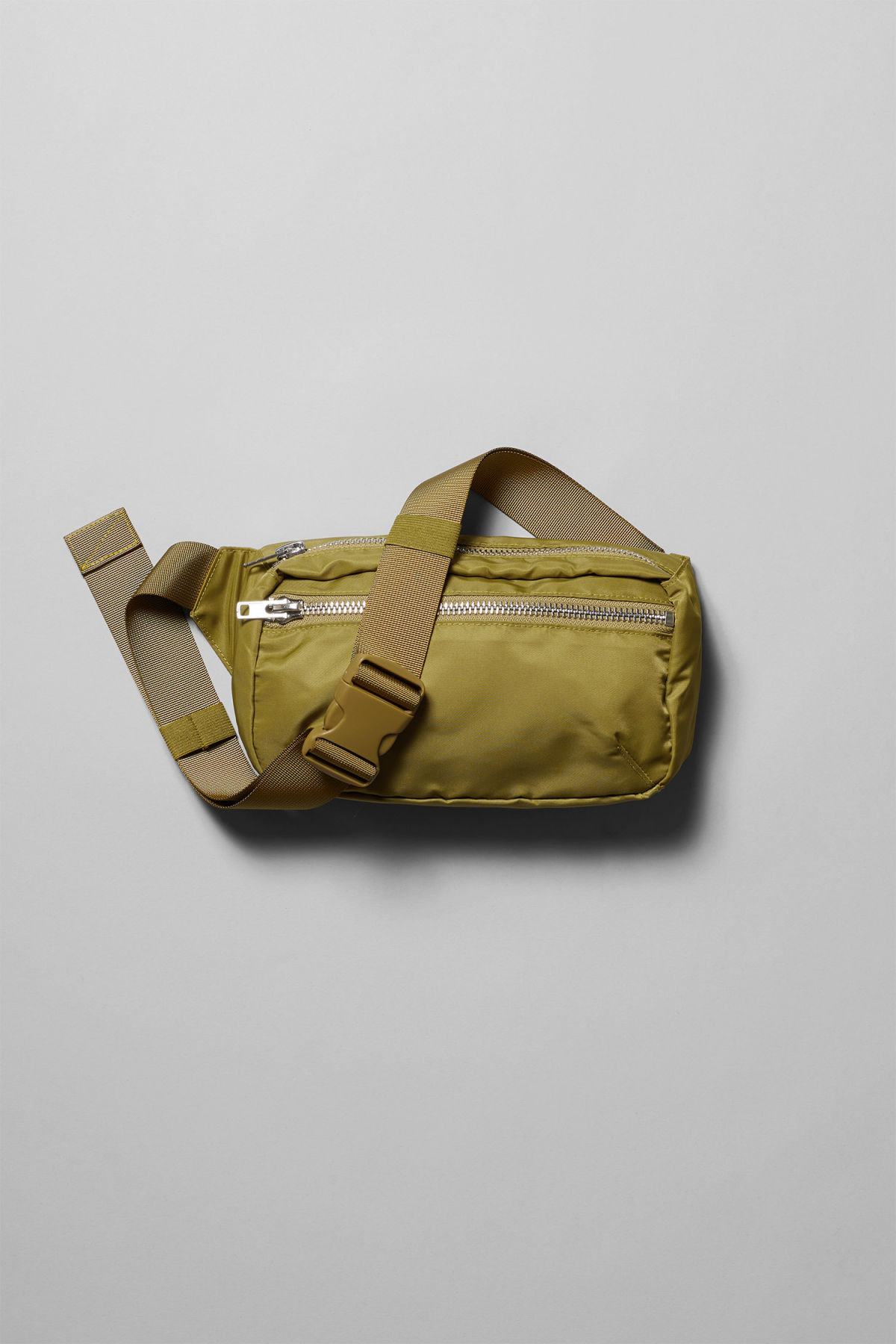 Front image of Weekday wood waist bag in yellow