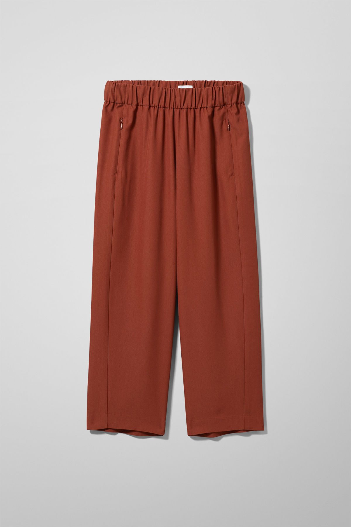 Front image of Weekday amelia woven trousers in orange
