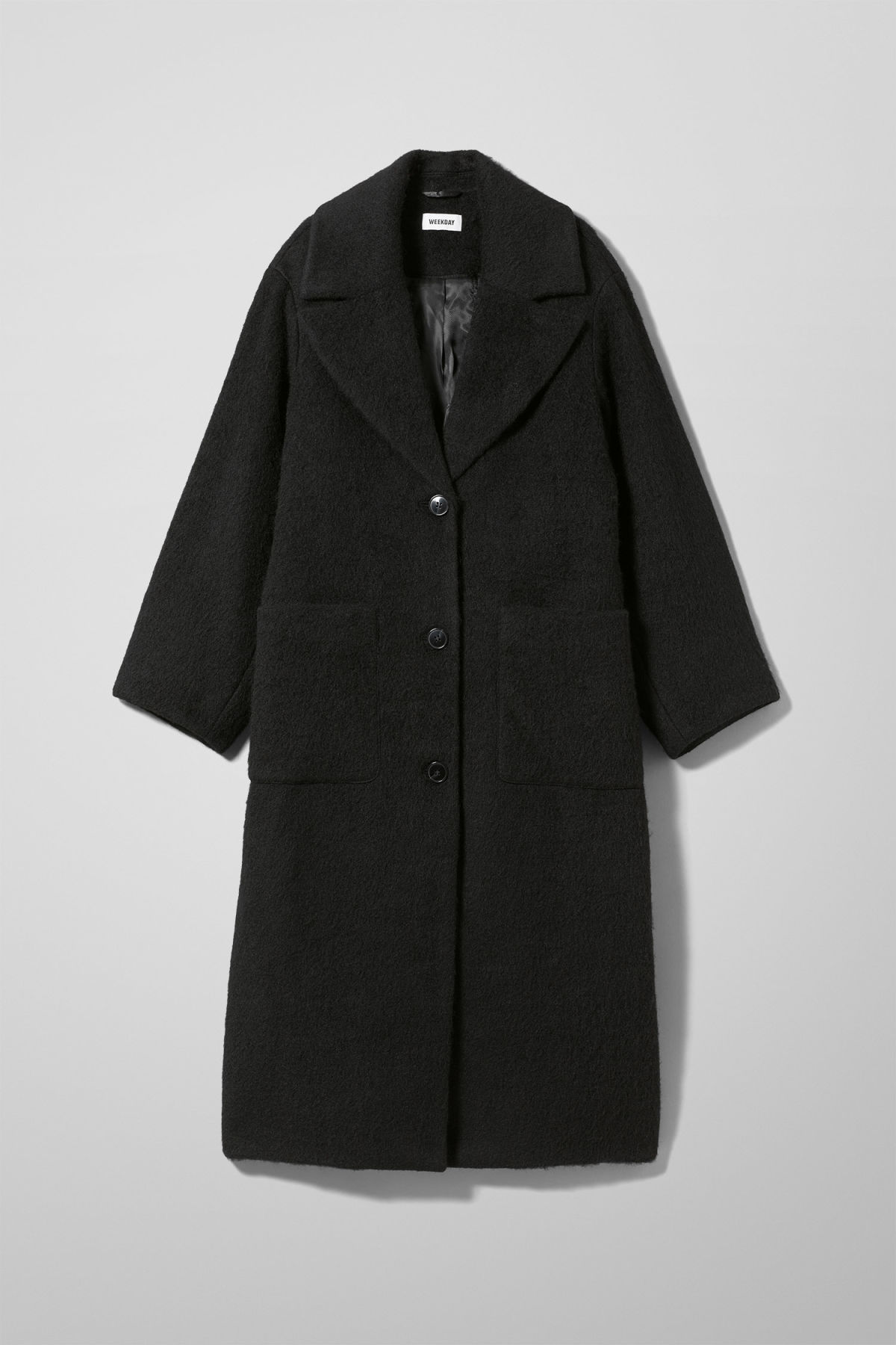 Front image of Weekday mario coat in black