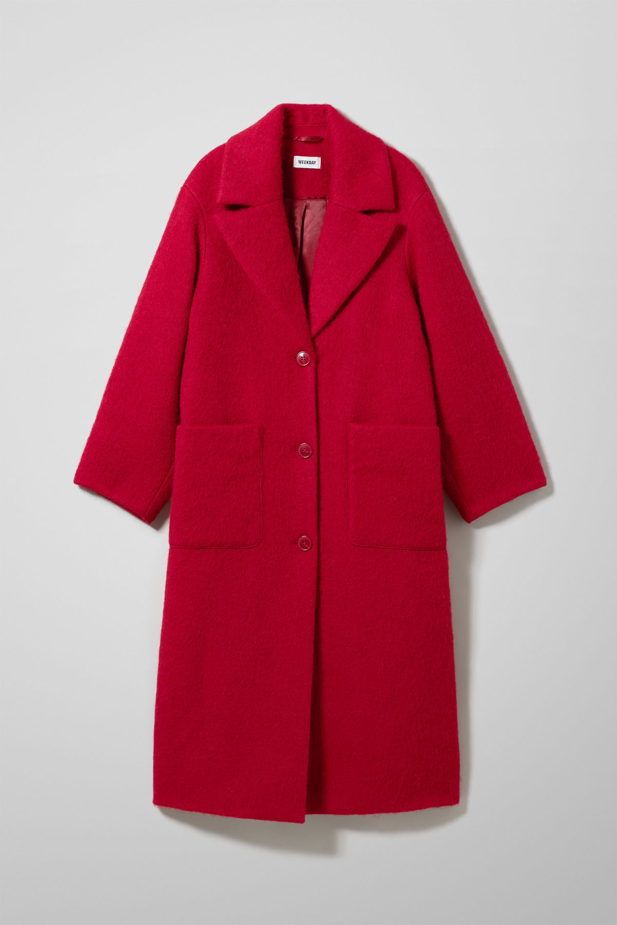 Front image of Weekday mario coat in red