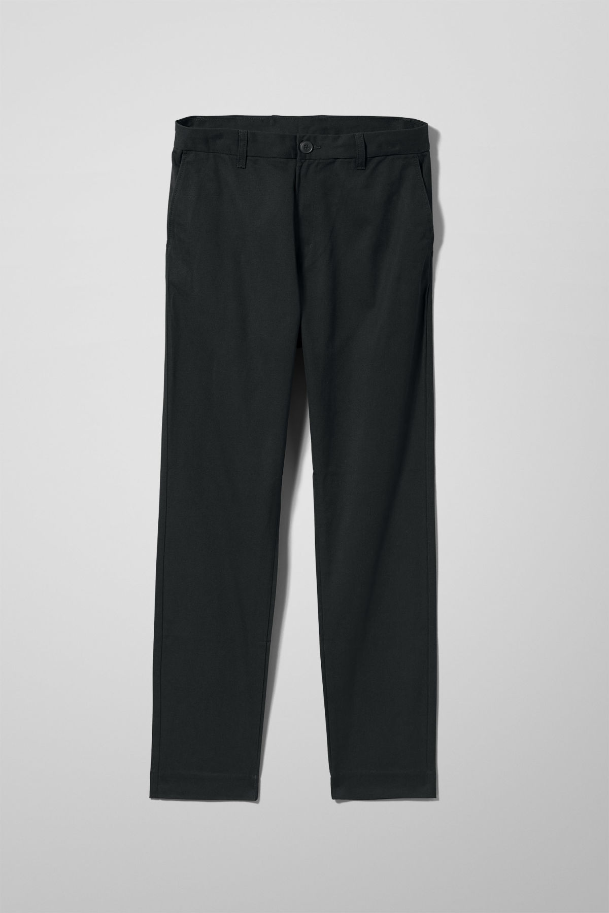 Front image of Weekday forest chinos in black