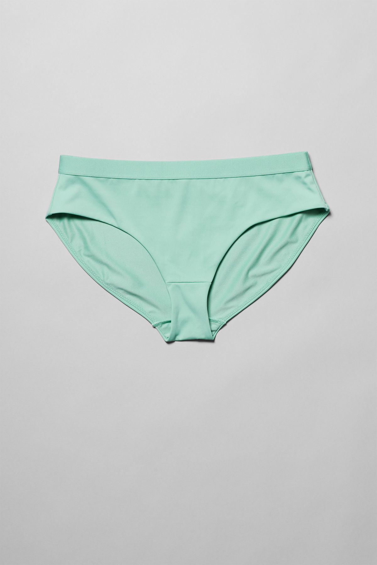 Front image of Weekday cay swim bottoms in green