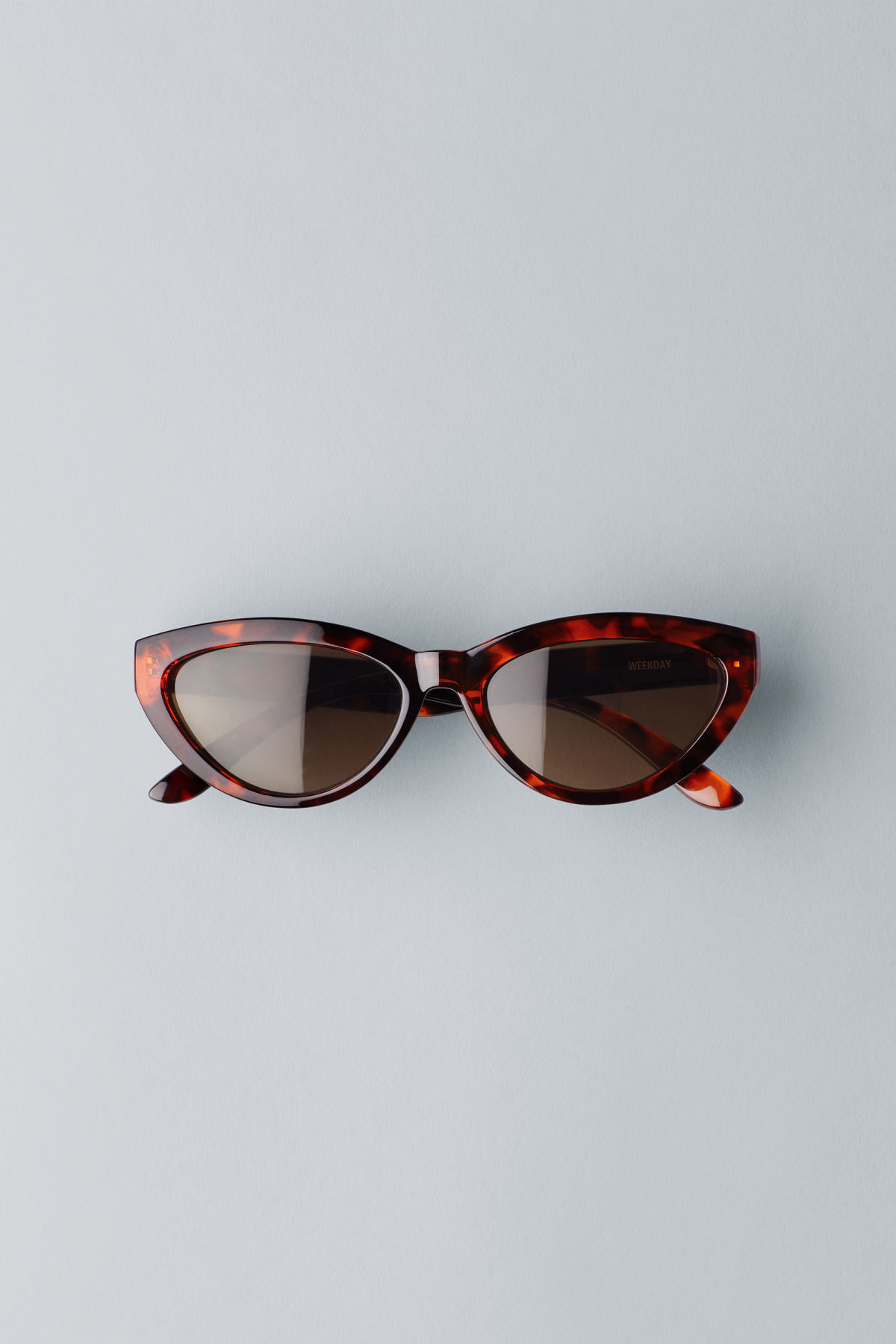 Front image of Weekday arrival cateye sunglasses in brown